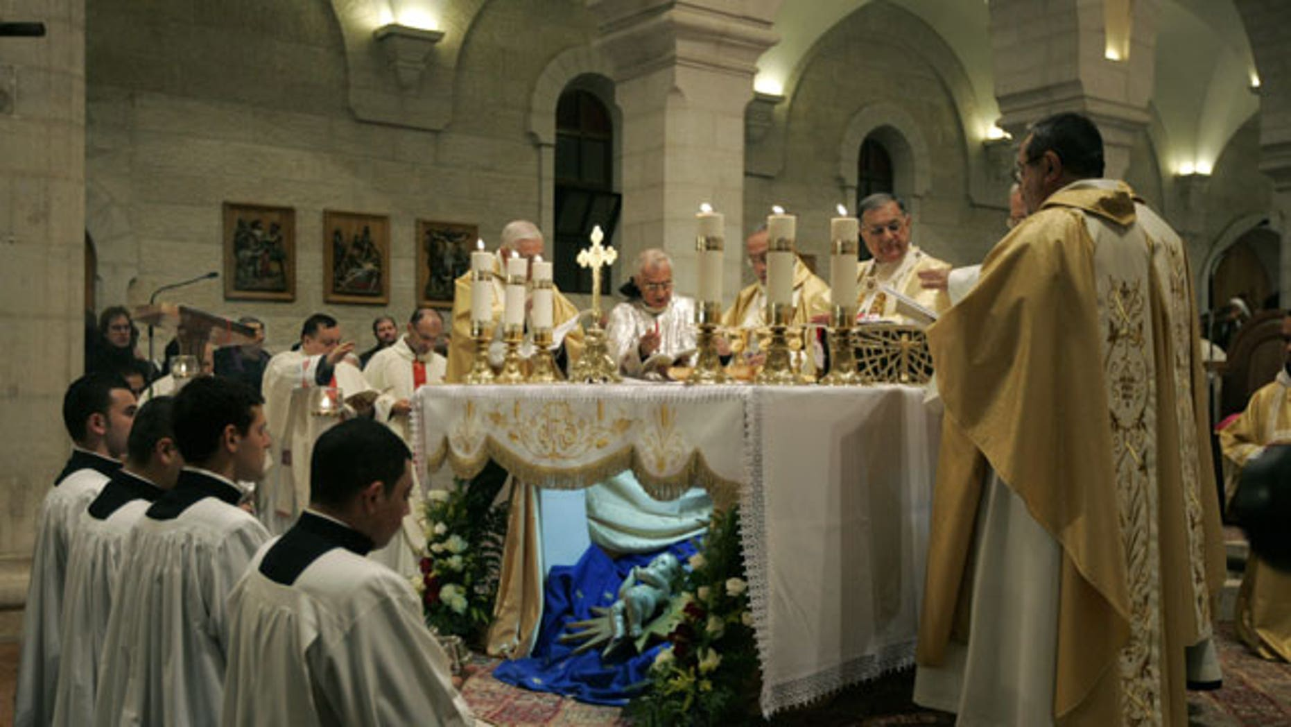 December 25, 2011: Christian priests hold the Christmas midnight Mass at the Church of the Nativity, traditionally believed to be the birthplace of Jesus Christ, in the West Bank town of Bethlehem.
