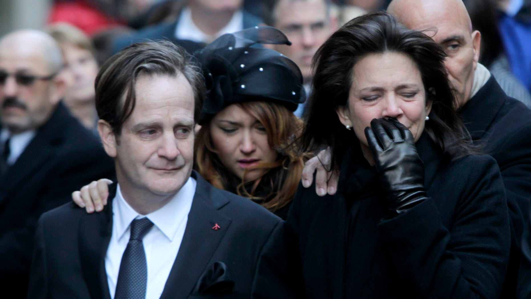 Jan. 5: Matthew Badger, left, and Madonna Badger, the parents of three children that were killed in a fire, react as their caskets are carried into a church during the funeral in New York.