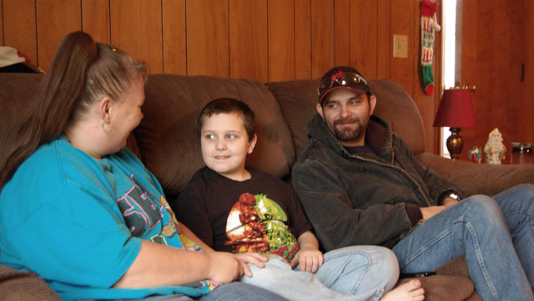 December 22, 2011: Kentucky mother Sandra Baker, left, sits with her son, Christopher, and husband, Scottie at Sandra's home, in Harrodsburg, Ky.