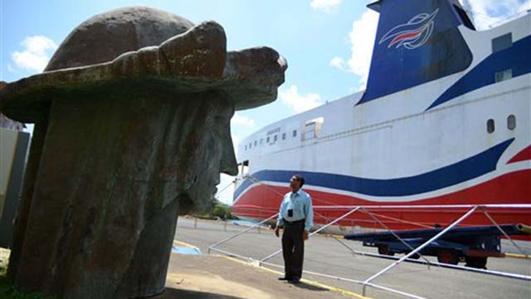 Sept. 2, 2011: Tony Jacobs, director of the port of Mayaguez, looks at the head of a statue of Christopher Columbus, one of many pieces strewn across the port storage area in Mayaguez, Puerto Rico.