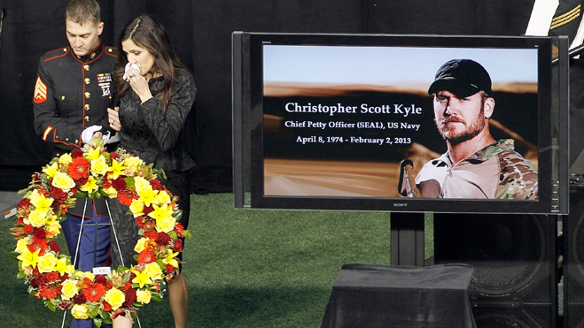 Feb. 11, 2013: In this file photo, Christopher Kyle's wife, Taya, is escorted to her seat after memorializing her husband in Arlington, Texas. Former Minnesota Gov. Jesse Ventura sued Chris Kyle, the author of the best-selling book American Sniper, for defamation in 2012 after Kyle claimed in his book that he punched Ventura at a California bar. Ventura says the incident never happened, and hes suing for damages. Kyle, of Texas, was killed last year on a gun range while the lawsuit was pending.