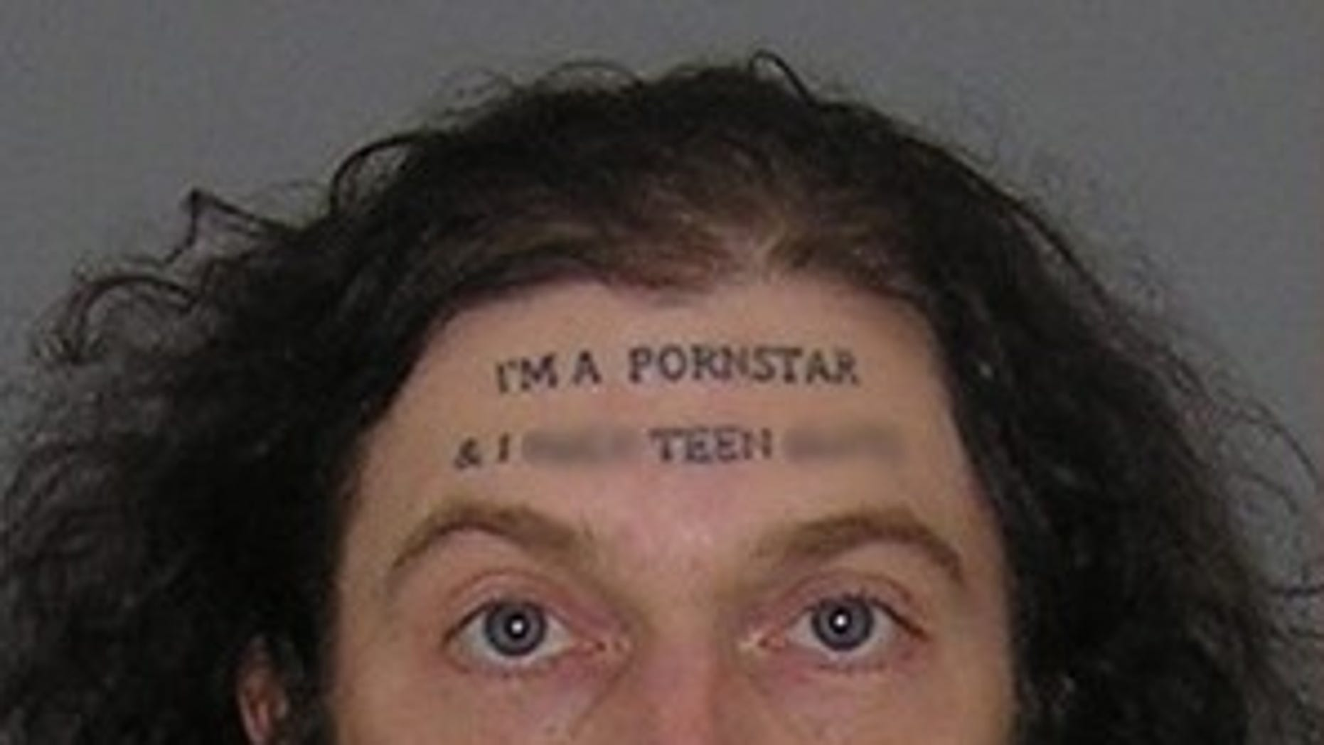 """Christopher Wilson, 37, who has """"I'm a pornstar"""" tattooed to his forehead, has been charged with sexual imposition and assault."""