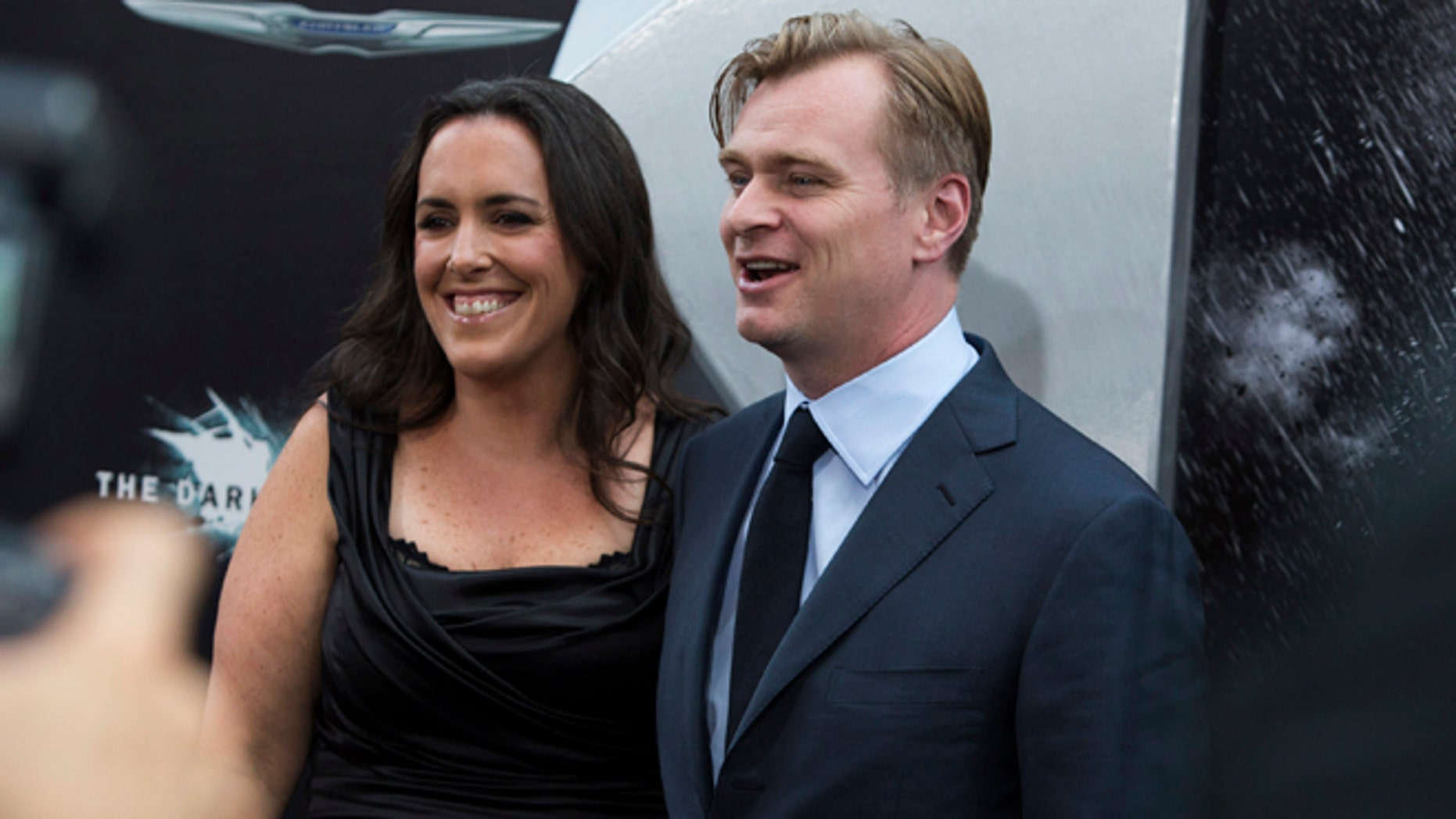 """July 16, 2012: Director Christopher Nolan (R) and wife Emma Thomas attend the world premiere of the movie """"The Dark Knight Rises"""" in New York."""