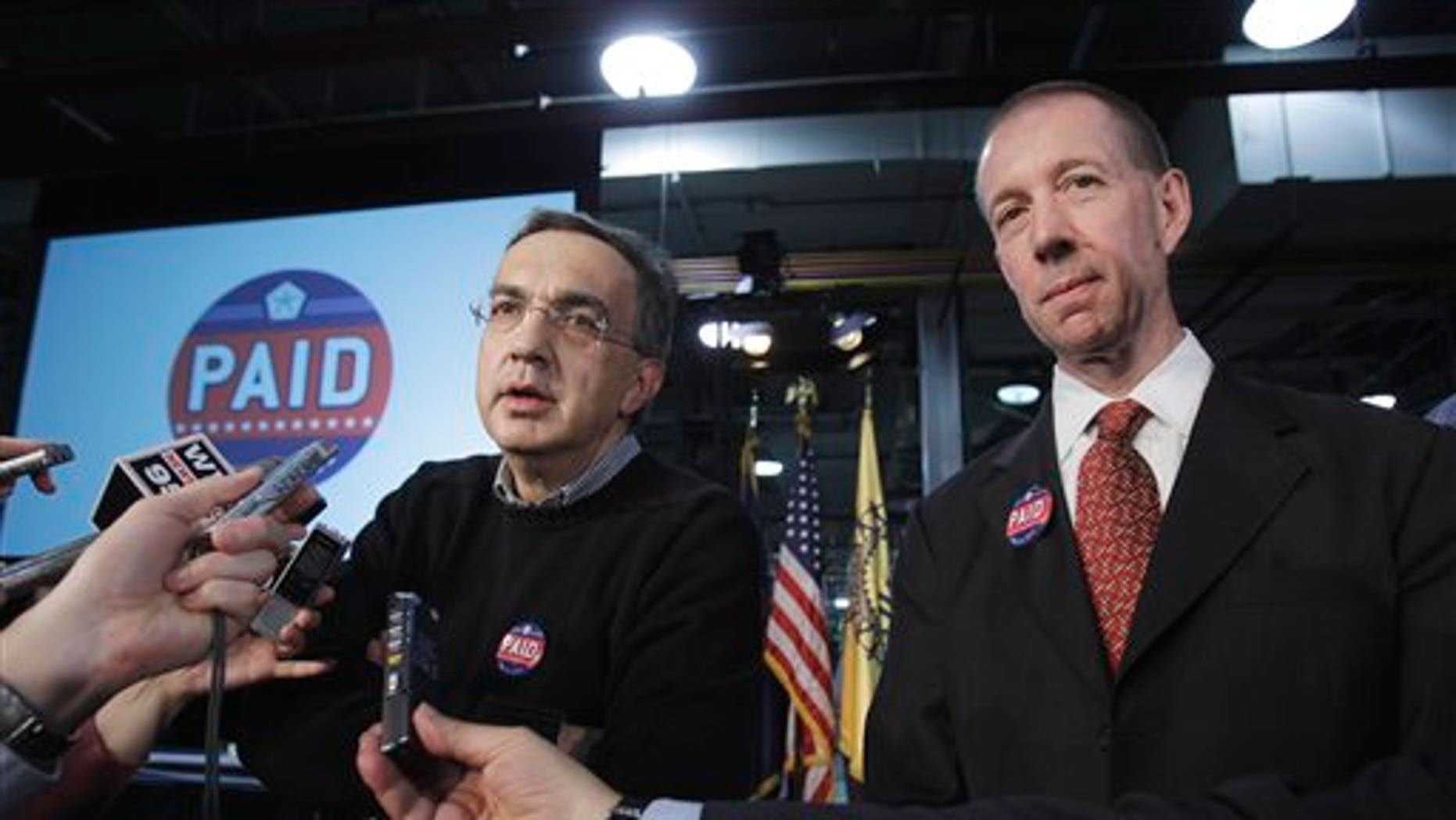 May 24: Chrysler Group CEO Sergio Marchionne, left, and Ron Bloom, assistant to President Obama for Manufacturing Policy talk to the media at the Sterling Heights Assembly Plant in Sterling Heights, Mich.