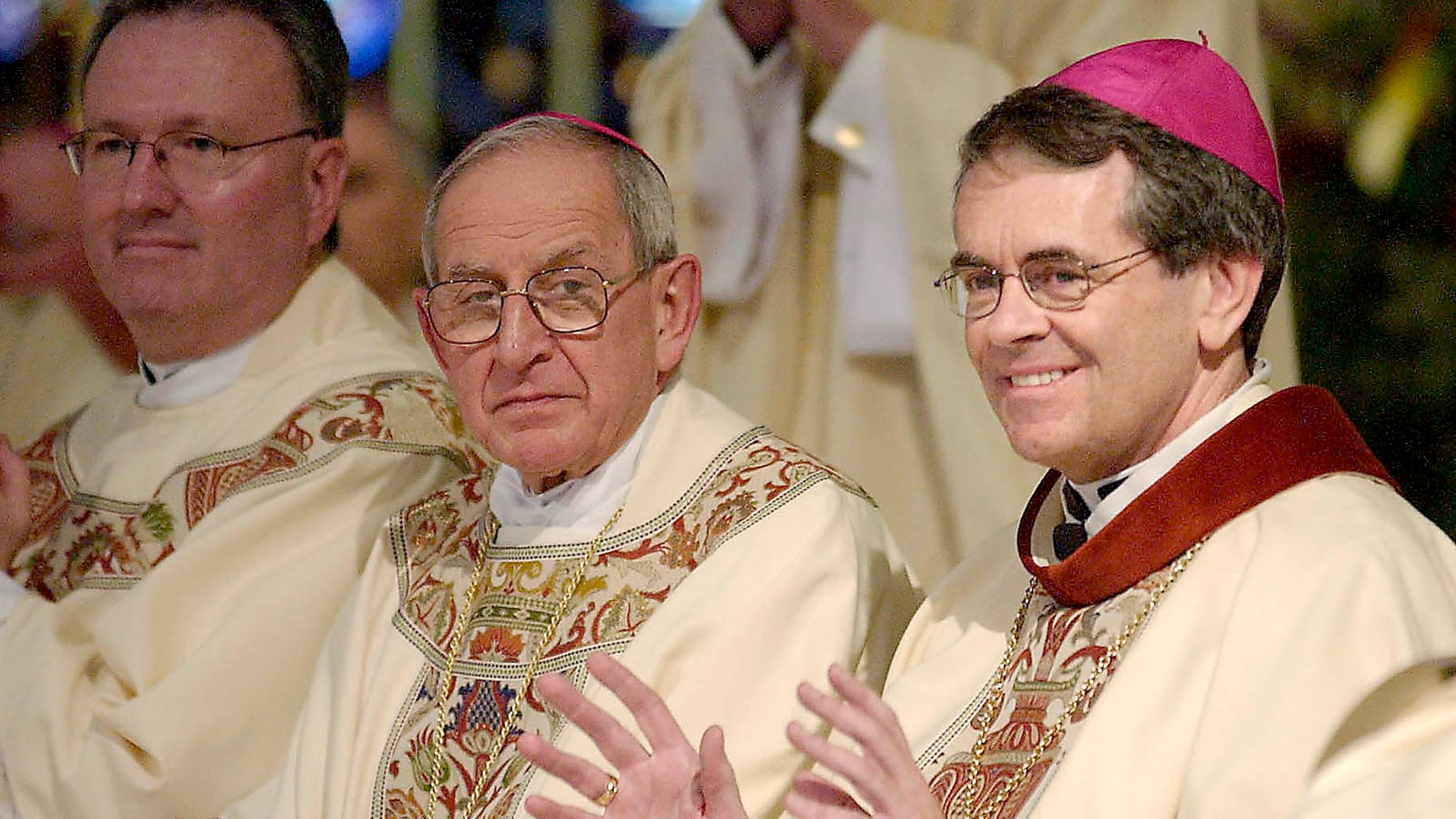 Bishop George Thomas, right, in a June 4, 2004 file photo.