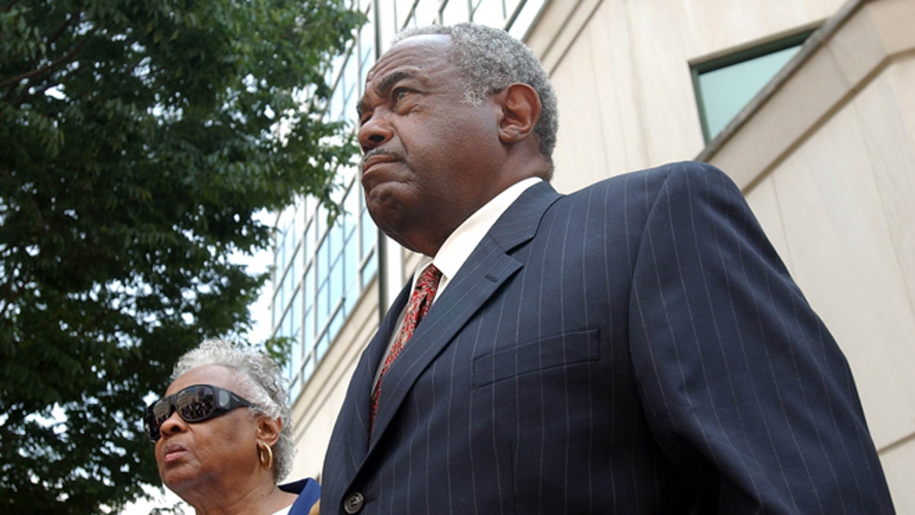 In this 2005 file photo, former Jefferson County Commissioner Chris McNair reacts outside of the Hugo L. Black Federal Courthouse in Birmingham, Ala., after being indicted on bribery, mail fraud and obstruction in the 1997 - 2003 Jefferson County sewer  operations.