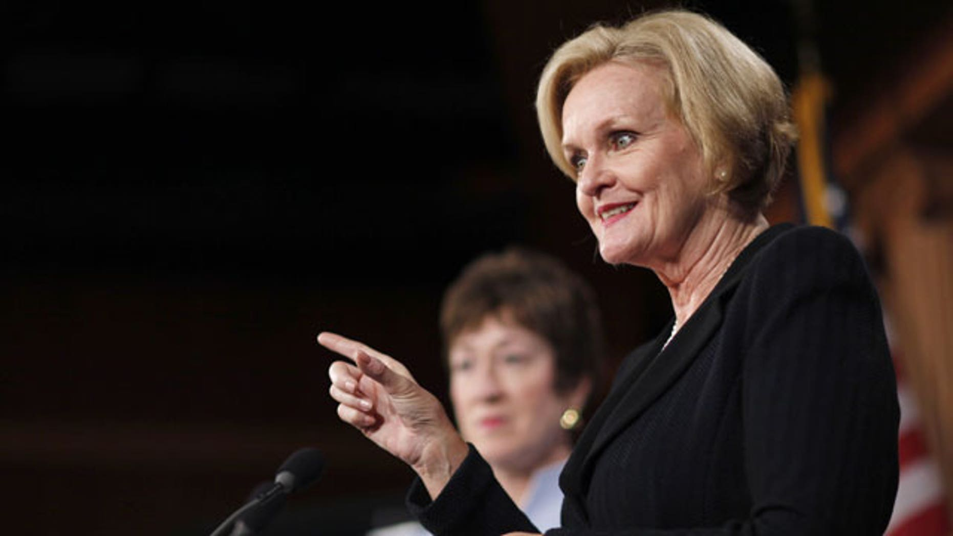 December 6, 2011: Sen. Claire McCaskill, D-Mo., right, accompanied by Sen. Susan Collins R-Maine, gestures during a news conference on Capitol Hill in Washington.