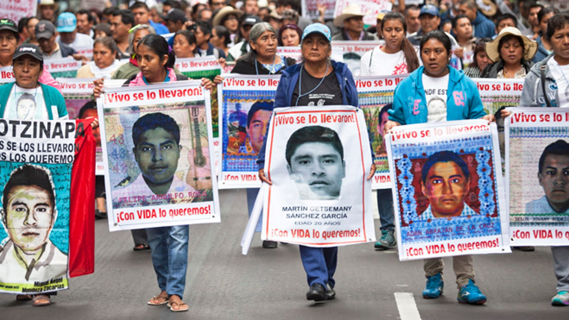 Family of 43 missing students from Ayotzinapa Normal school lead a protest, September 26, 2015 in Mexico City.