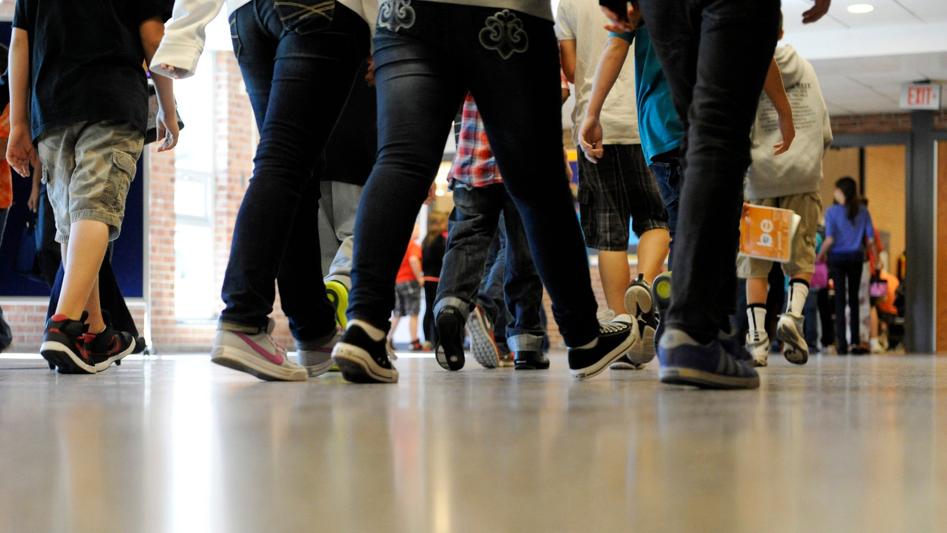 Sept. 11, 2012: File photo, students walk in the hallways as they enter the lunch line of the cafeteria at Draper Middle School in Rotterdam, N.Y. School for thousands of public school students is about to get quite a bit longer. Five states announced Monday, Dec. 3, 2012, they will add at least 300 hours of learning time to the calendar in some schools starting in 2013.