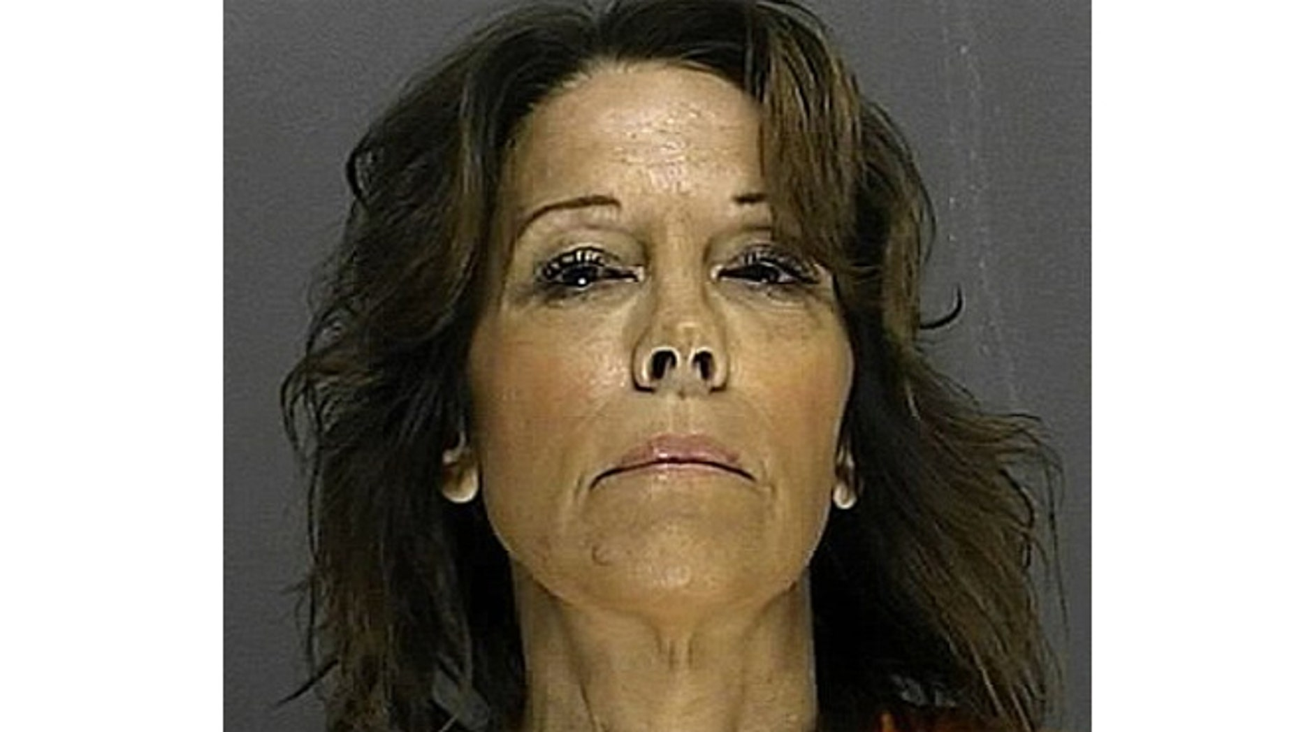Claudia Ambroziak was arrested after acting out how she says her husband tried to choke her on a police officer.