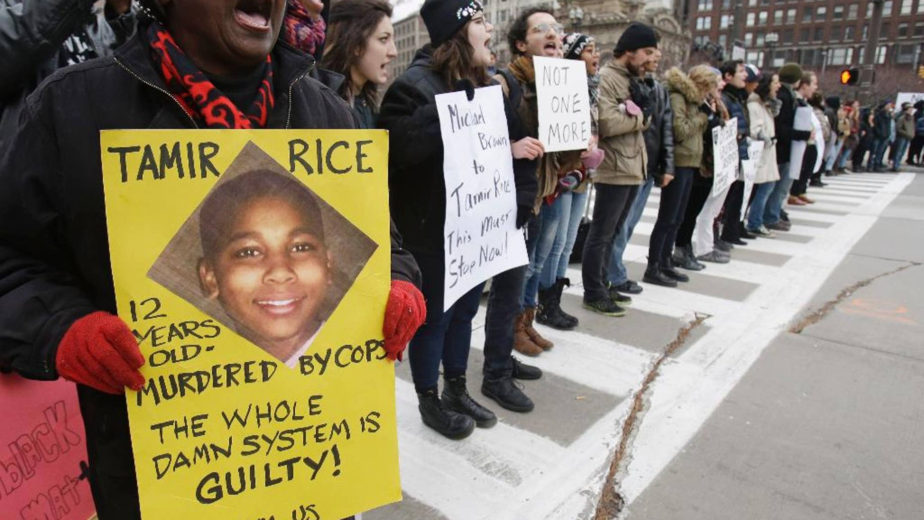 FILE- In this Nov. 25, 2014, file photo, demonstrators block Public Square Tuesday, Nov. 25, 2014, in Cleveland, during a protest over the police shooting of  12-year-old Tamir Rice. Cleveland's politicians and community leaders are now working to make sure protests remain peaceful as the city awaits a verdict in the trial of a white officer in the deaths of the two unarmed people and a decision on whether charges will be filed in Rice's death. (AP Photo/Tony Dejak, File)