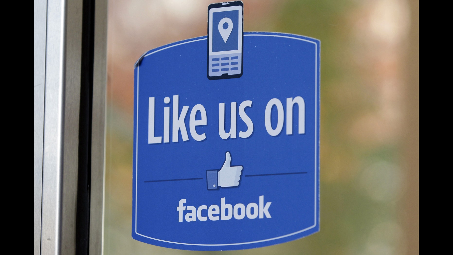 """FILE - In this Dec. 13, 2011 file photo, a sign with Facebook's """"Like"""" logo is posted at Facebook headquarters near the office for the company's User Operations Safety Team in Menlo Park, Calif.  Celebrities, businesses and even the U.S. State Department have bought bogus Facebook likes, Twitter followers or YouTube viewers from offshore """"click farms,"""" where workers tap, tap, tap the thumbs up button, view videos or retweet comments to inflate social media numbers. (AP Photo/Paul Sakuma, File)"""