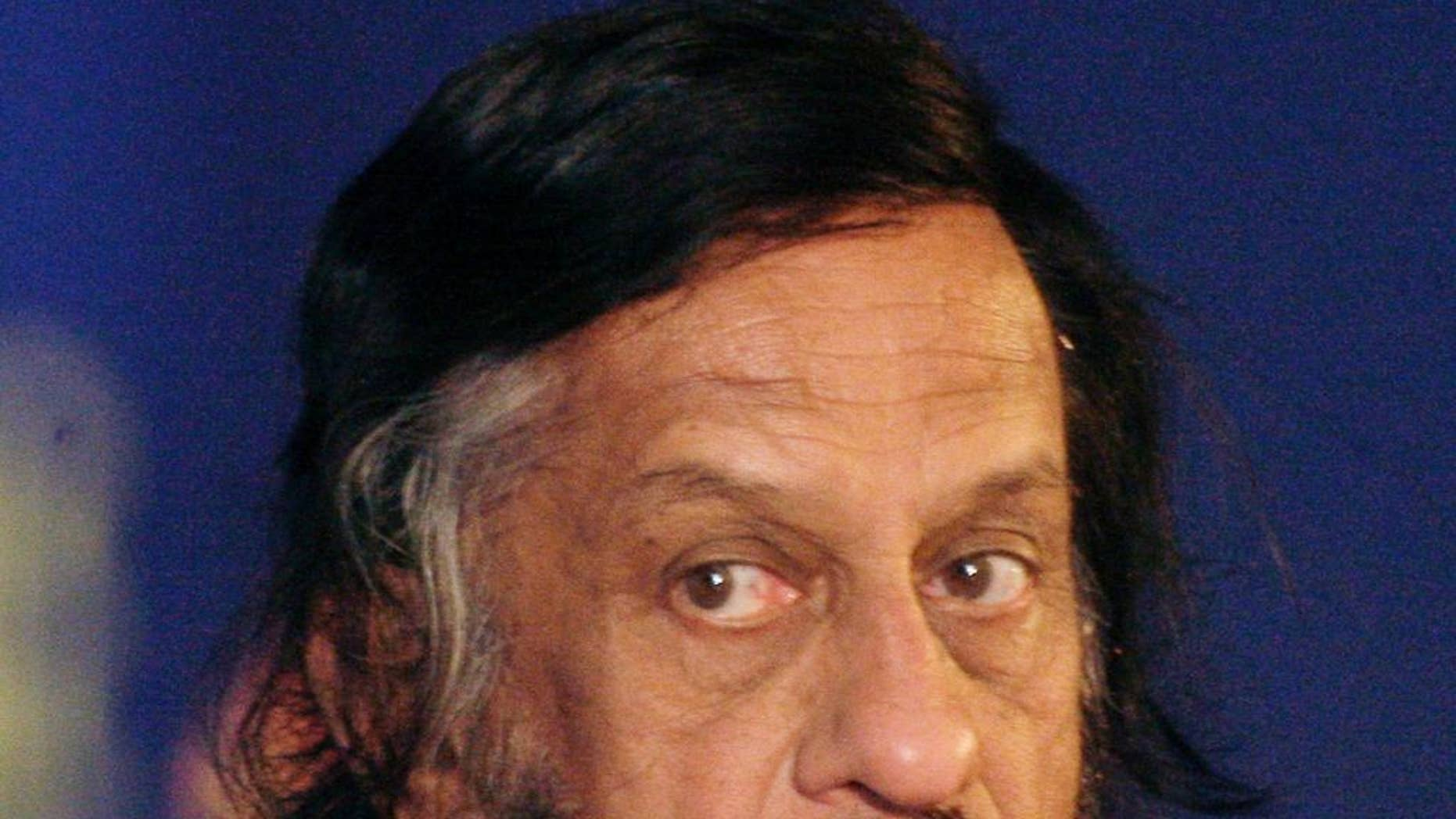 In this Feb. 6, 2010 file photo, Intergovernmental Panel on Climate Change Chairman Rajendra Pachauri listens to a speaker at the Delhi Sustainable Development Summit in New Delhi, India.