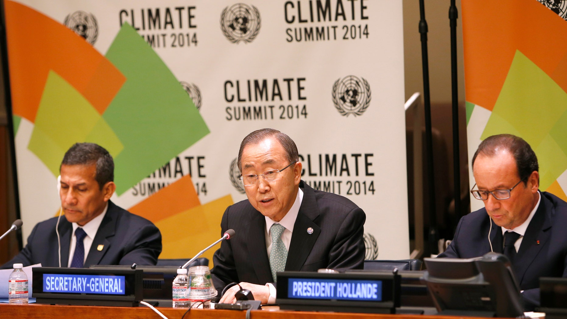 U.N. Secretary-General Ban Ki-moon, center, is joined by President Ollanta Humala of Peru, left, and President Francois Hollande of France at a news conference on climate change.
