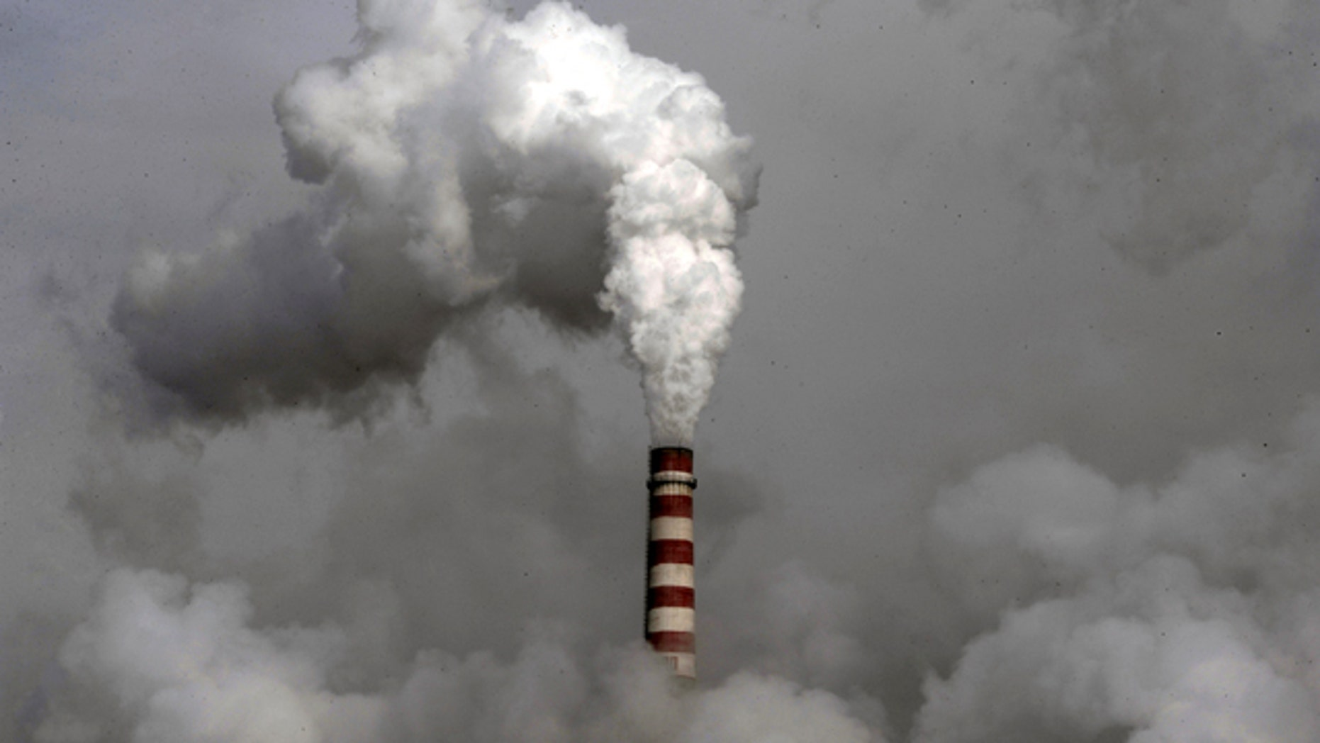 Smoke billows from the chimney of the cooling towers of a coal-fired power plant in Dadong, Shanxi province, China. Two weeks of United Nations climate talks in Bonn came up with a sketchy new draft for a deal to halt global warming, but some nations immediately raised concerns and observers said Friday, June 11, 2010, there is little substantial progress.