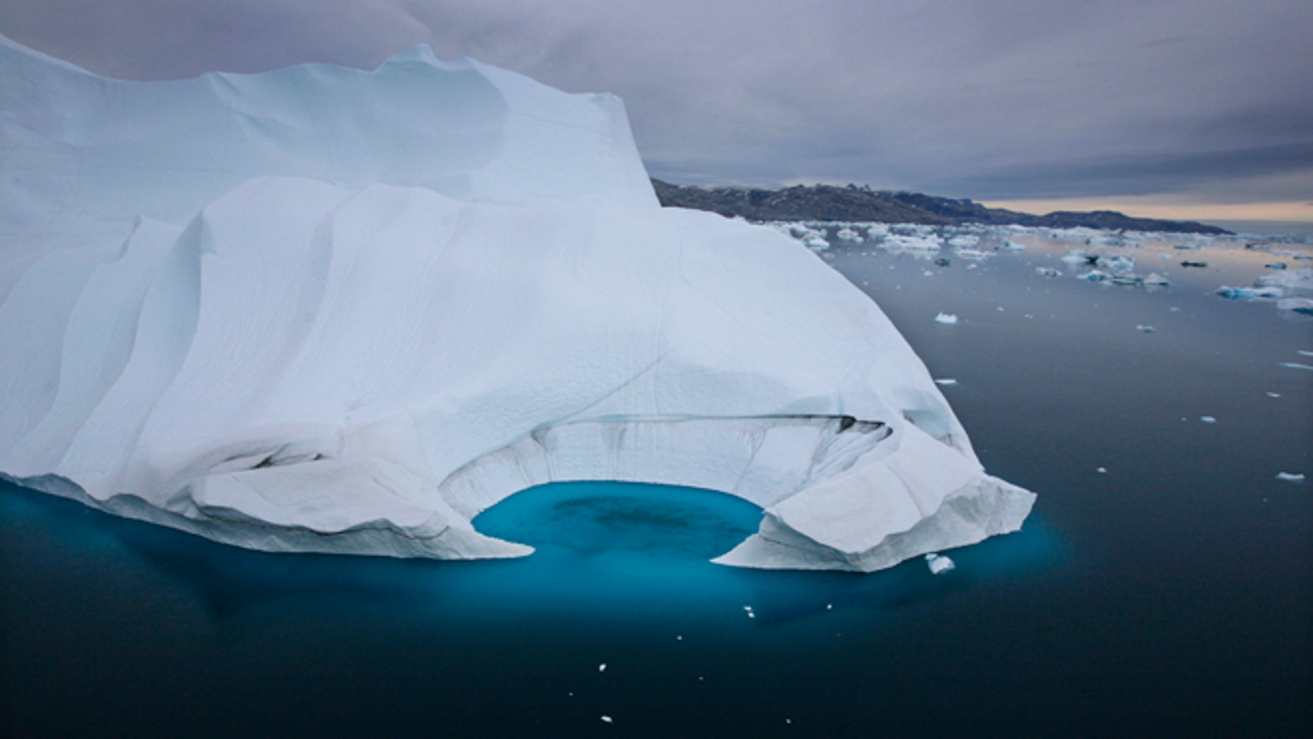 Scientists who are fine-tuning a landmark U.N. report on climate change are struggling to explain why global warming appears to have slowed down in the past 15 years even as greenhouse gas emissions keep rising.