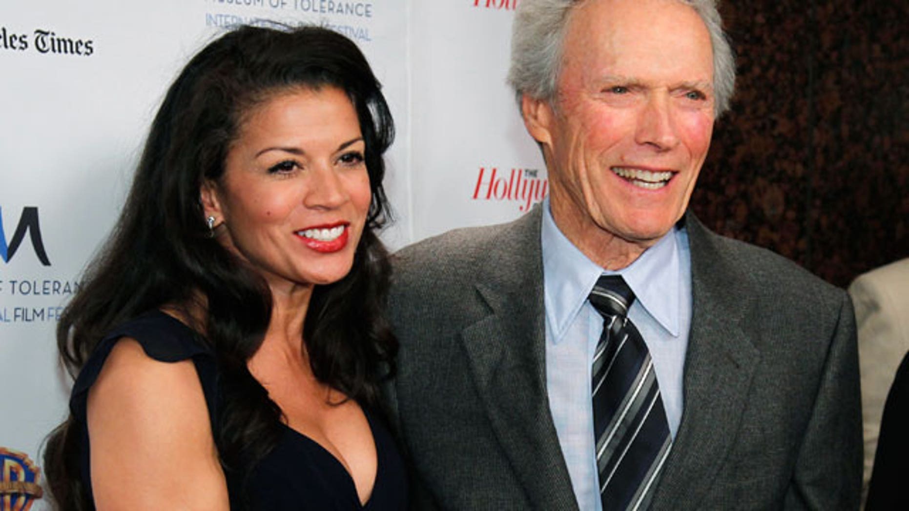 Nov. 14: Director Clint Eastwood (R) and his wife Dina Ruiz Eastwood arrive at the Museum of Tolerance International Film Festival gala awards presentation in his honor in Los Angeles. (Reuters)