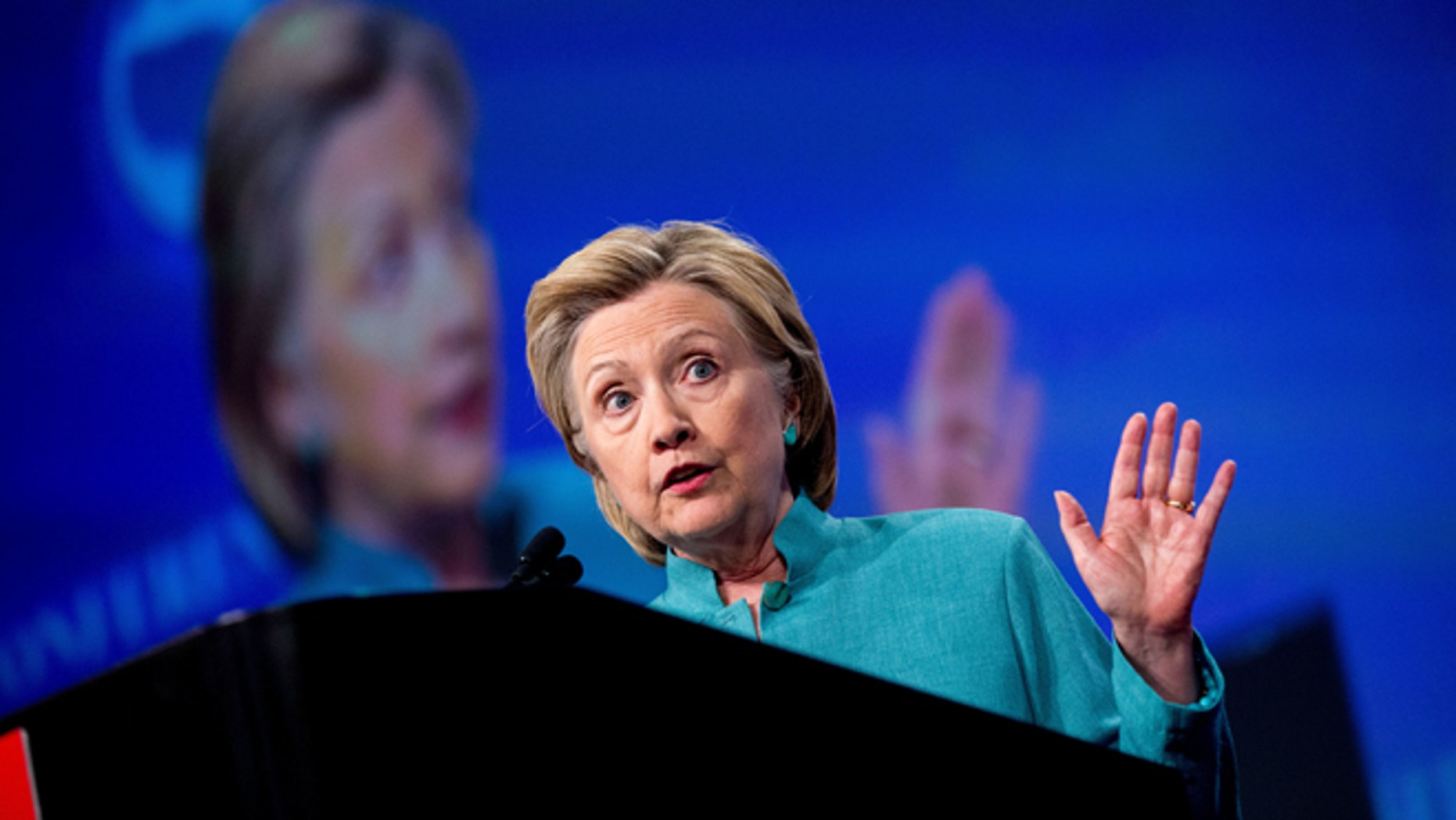 Democratic presidential candidate Hillary Clinton speaks at the U.S. Conference of Mayors in Indianapolis, Sunday, June 26, 2016, on the United Kingdom's vote to leave the European Union, America's economy, and other issues. (AP Photo/Andrew Harnik)