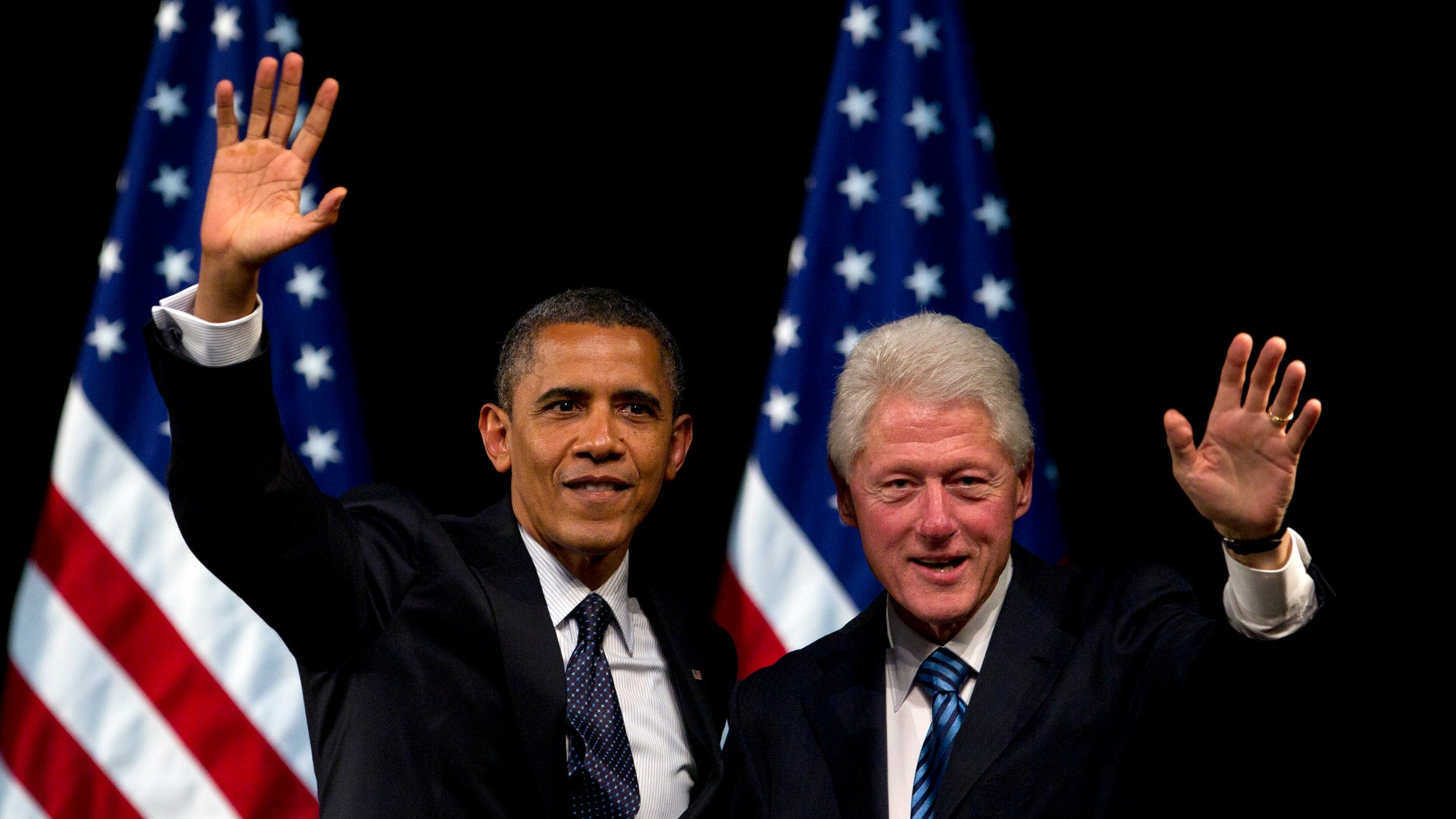 June 4, 2012: President Barack Obama and former President Bill Clinton wave to the crowd during a campaign event at the New Amsterdam Theater in New York.
