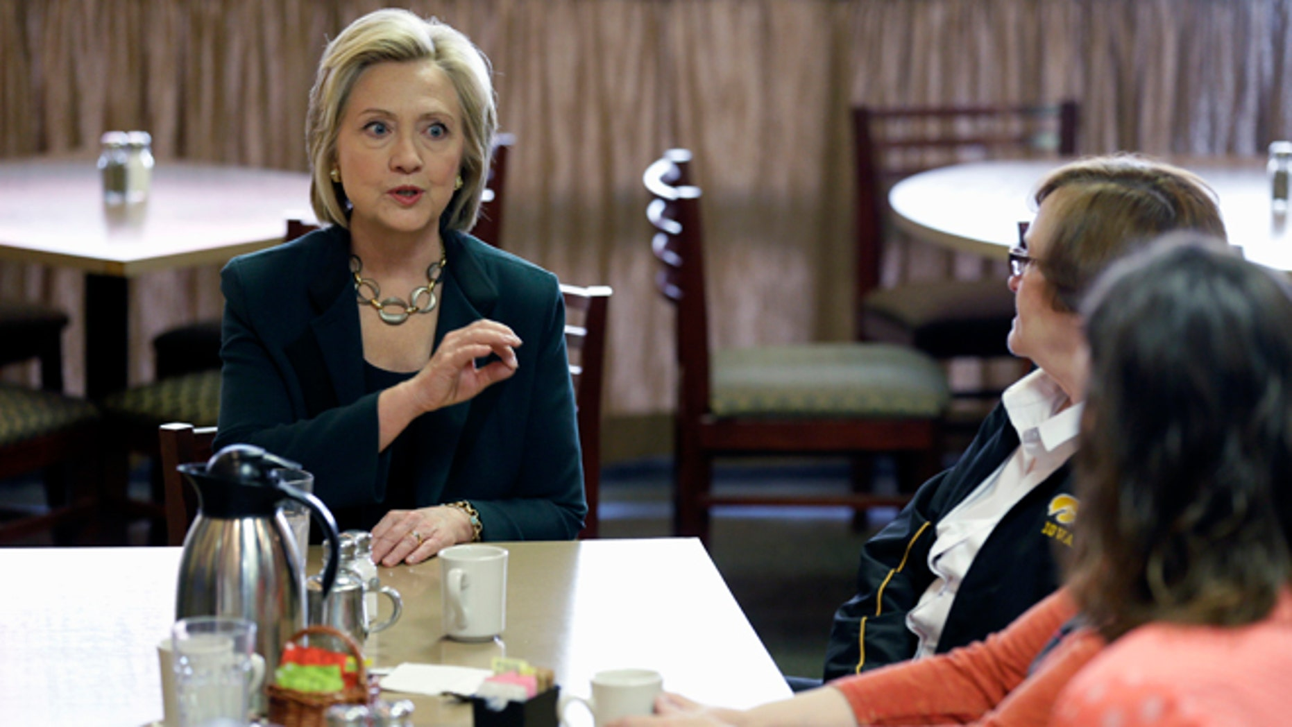 Democratic presidential candidate Hillary Rodham Clinton, left, visits with local residents at The Tremont, Wednesday, April 15, 2015, in Marshalltown, Iowa. (AP Photo/Charlie Neibergall)