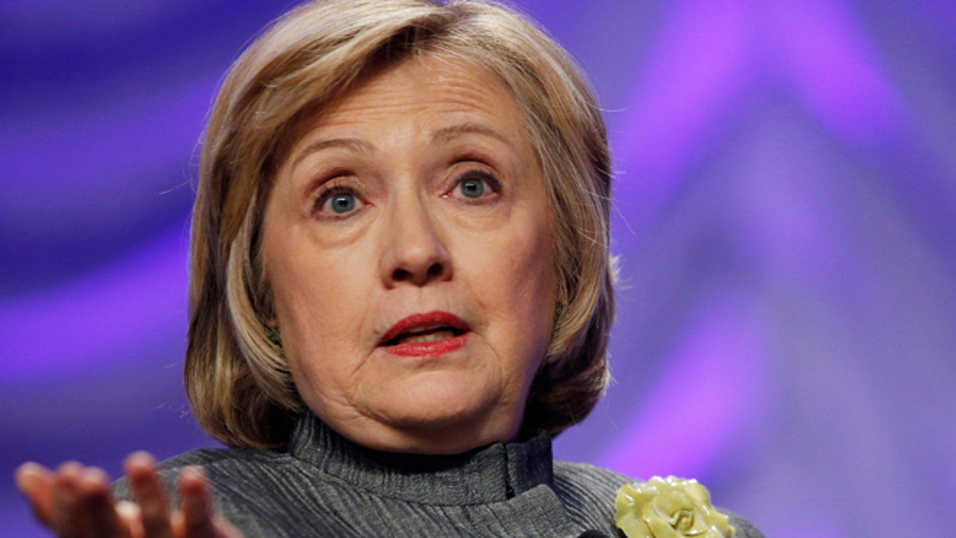 """FILE -This May 6, 2014 file photo shows Former Secretary of State Hillary Rodham Clinton speaking in National Harbor, Md. To congressional Republicans, """"Benghazi"""" is shorthand for incompetence and cover-up. Democrats hear it as the hollow sound of pointless investigations. It is, in fact, a Mediterranean port city in Libya that was the site of an attack on an American diplomatic compound on the 11th anniversary of 9/11 that killed U.S. Ambassador Chris Stevens and three other Americans. That's nearly all that U.S. politicians can agree on about Benghazi.  (AP Photo/Charles Dharapak, File)"""