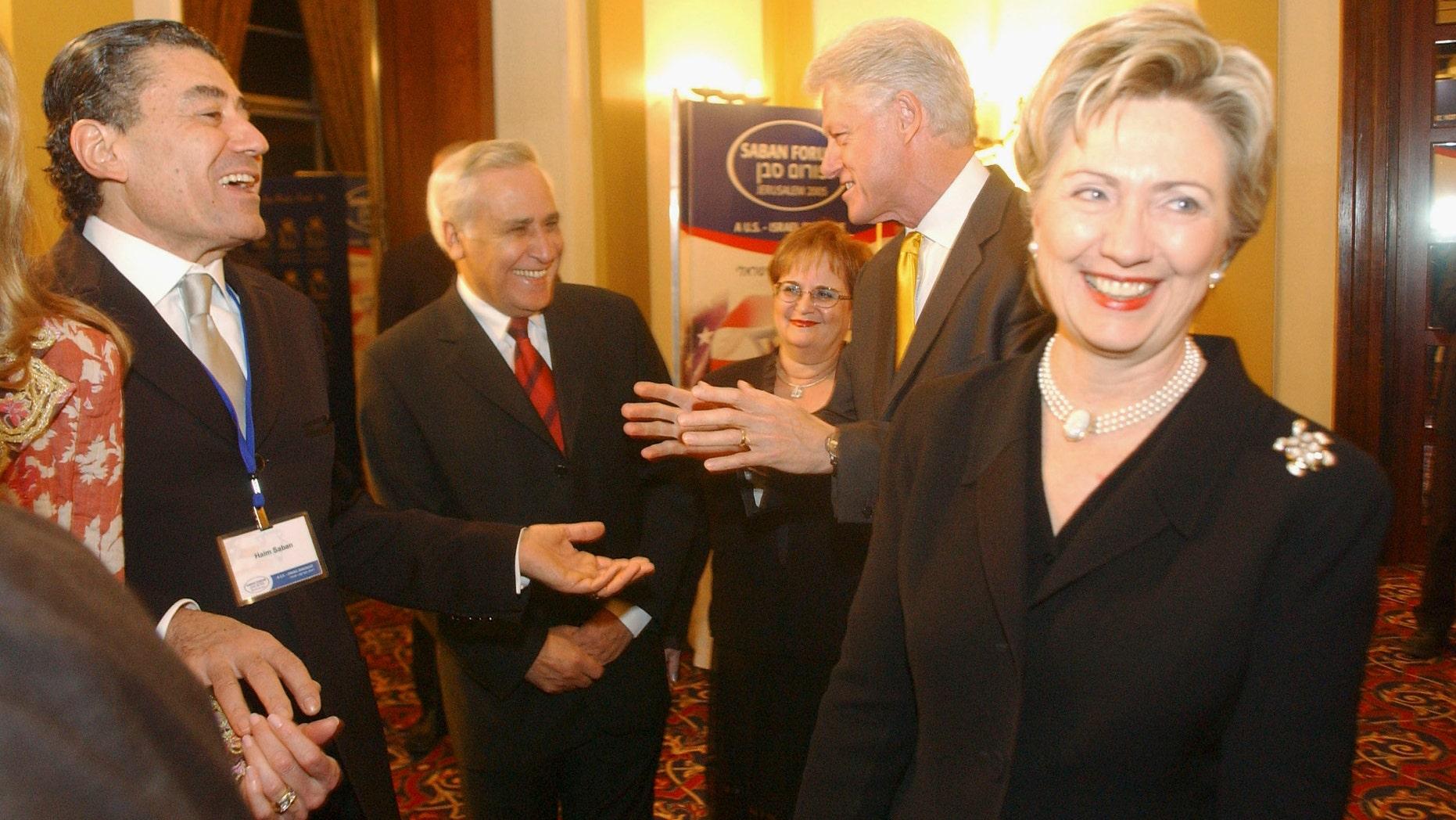 The U.S. Senator Hillary Clinton and former President Bill Clinton with Moshe Kazav and Haim Saban on Nov. 12, 2005 in Jerusalem, Israel.