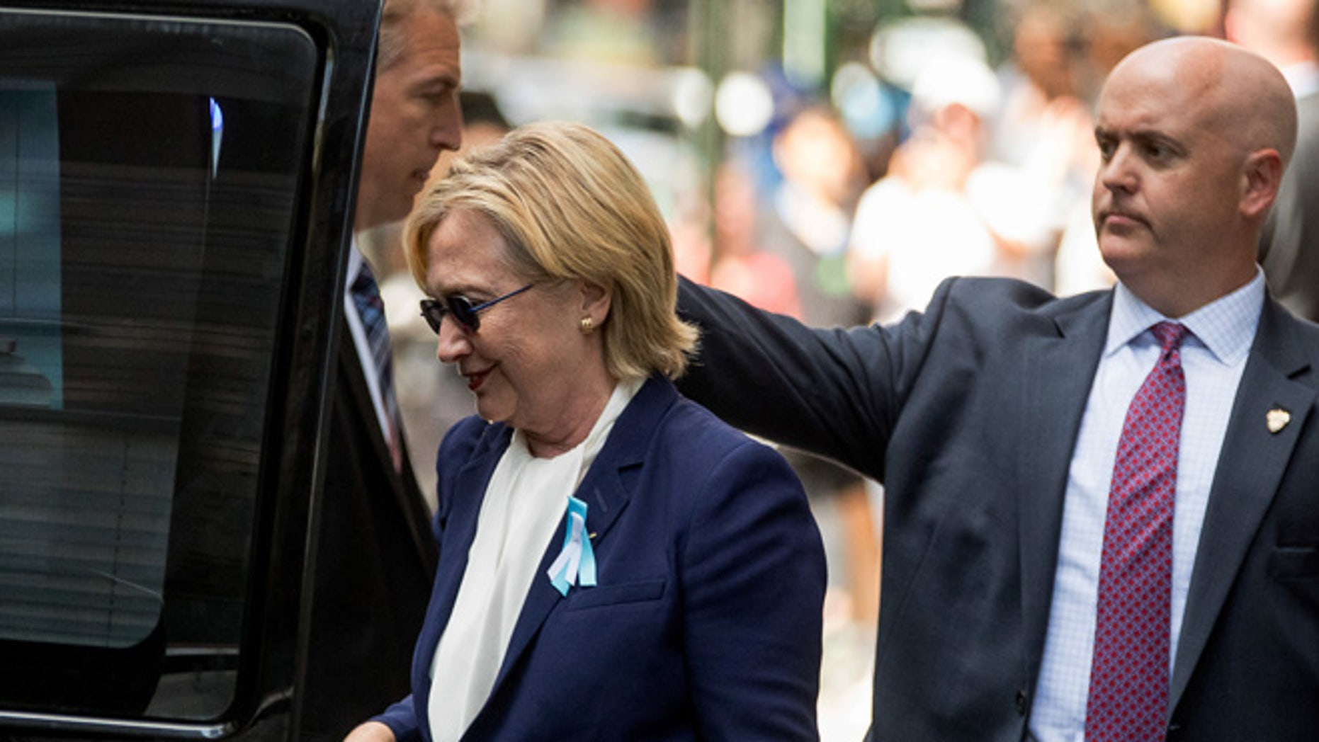 Presidential candidate Hillary Clinton leaves an apartment building Sunday, Sept. 11, 2016, in New York.