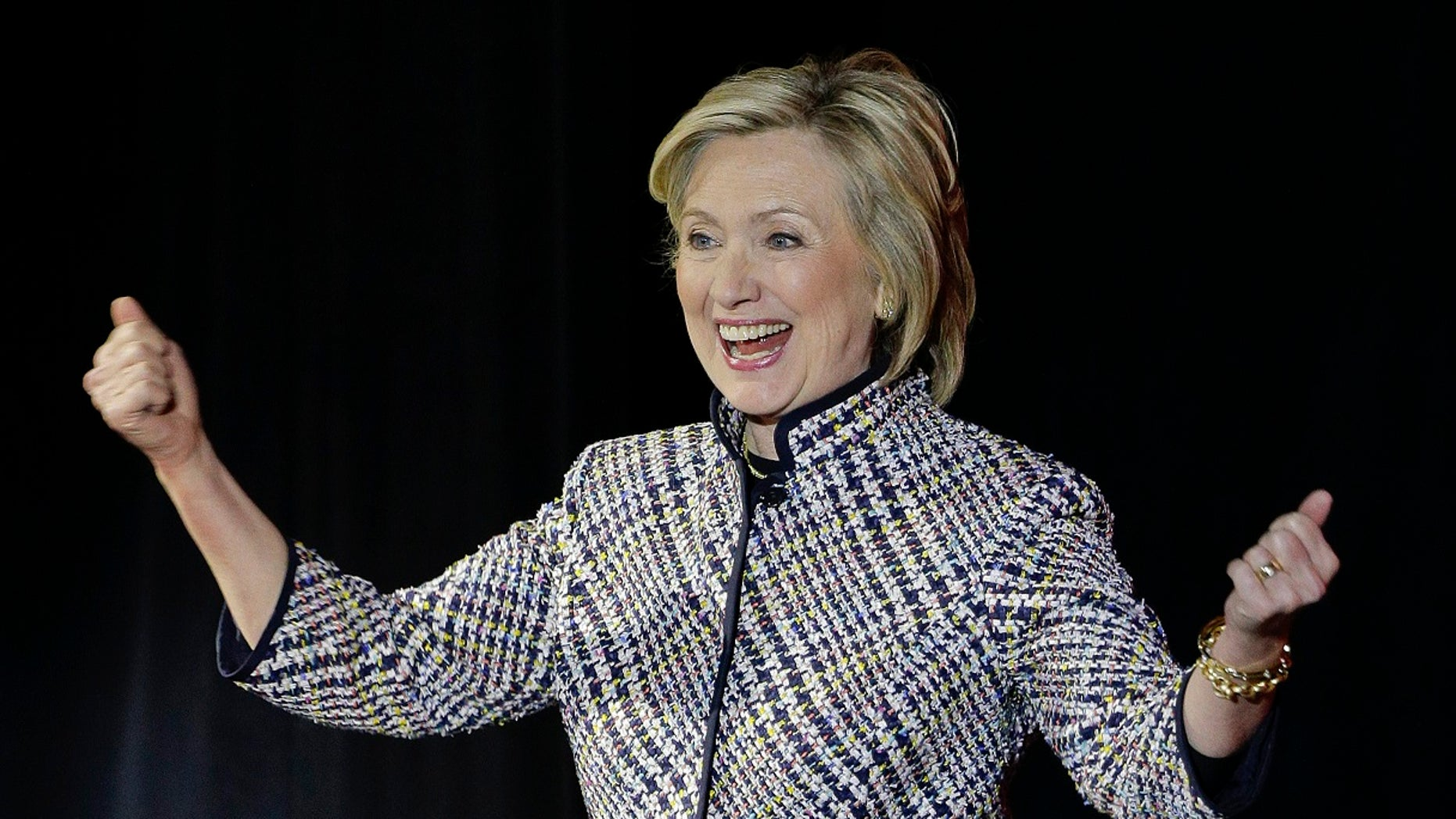 Hillary Rodham Clinton reacts to applause from the crowd before speaking during the sixth annual Women in the World Summit, Thursday, April 23, 2015, in New York. (AP Photo/Julie Jacobson)