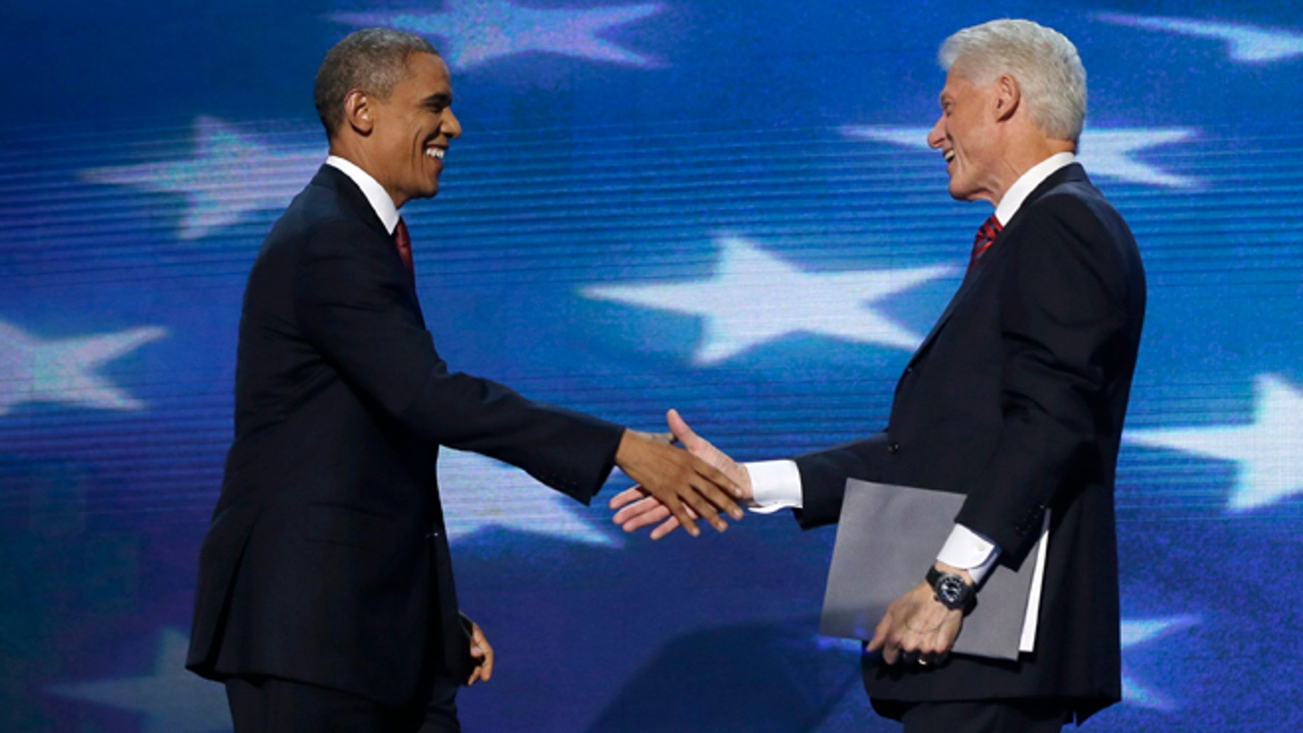 Sept. 5, 2012: President Barack Obama shakes hands with Former President Bill Clinton during the Democratic National Convention in Charlotte, N.C.