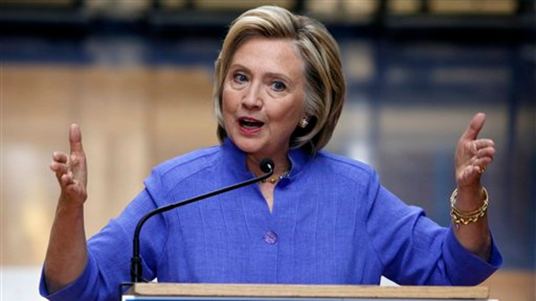Aug. 10: Democratic presidential candidate Hillary Clinton answers reporters questions after announcing her college affordability plan at the high school in Exeter, N.H.