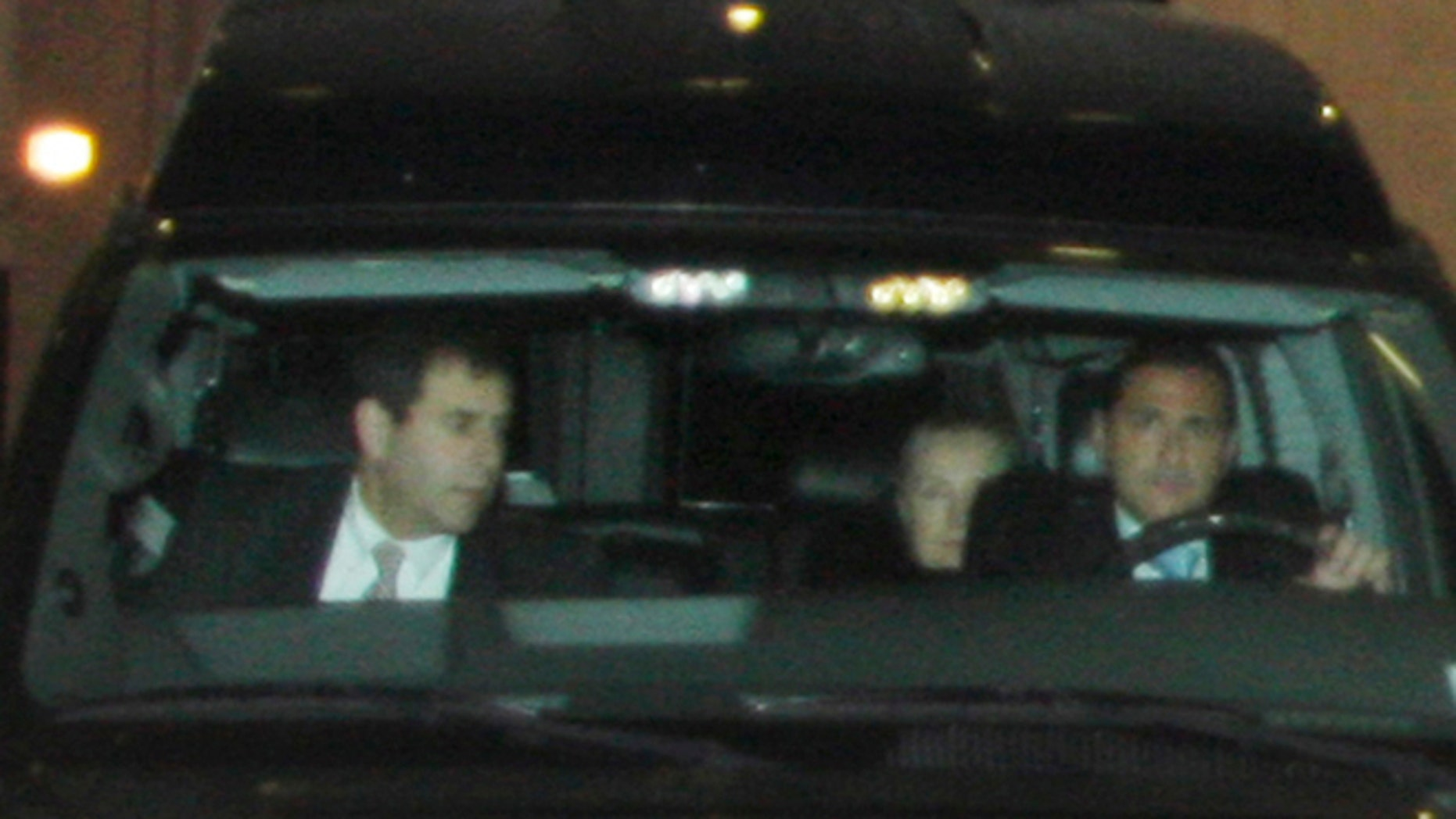 Jan. 2, 2013: U. S. secretary of State Hillary Rodham Clinton, right rear, leaves New York-Presbyterian Hospital after being discharged.