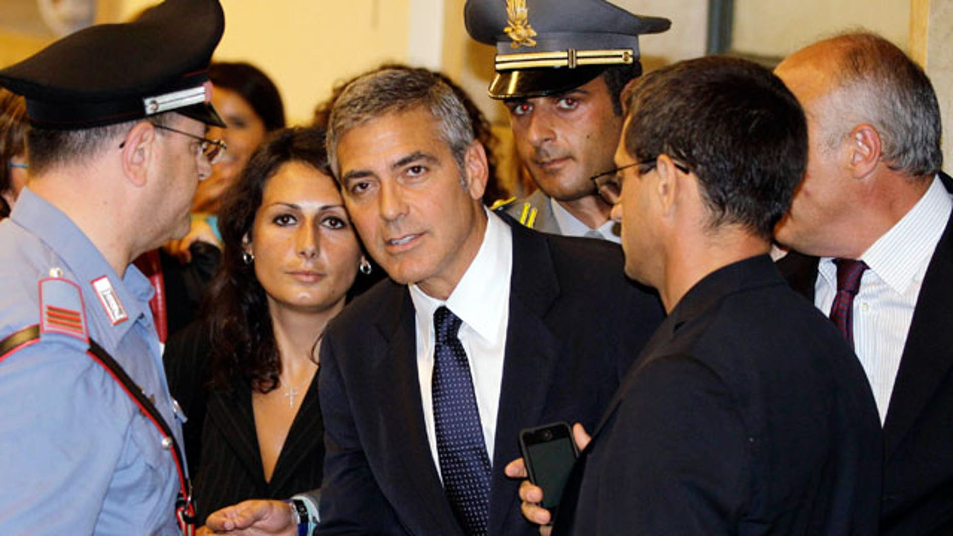 July 16: Actor George Clooney leaves a tribunal in Milan, Italy. Clooney appeared in court as a witness in a fraud trial against defendants charged with co opting his name for a line of clothing.