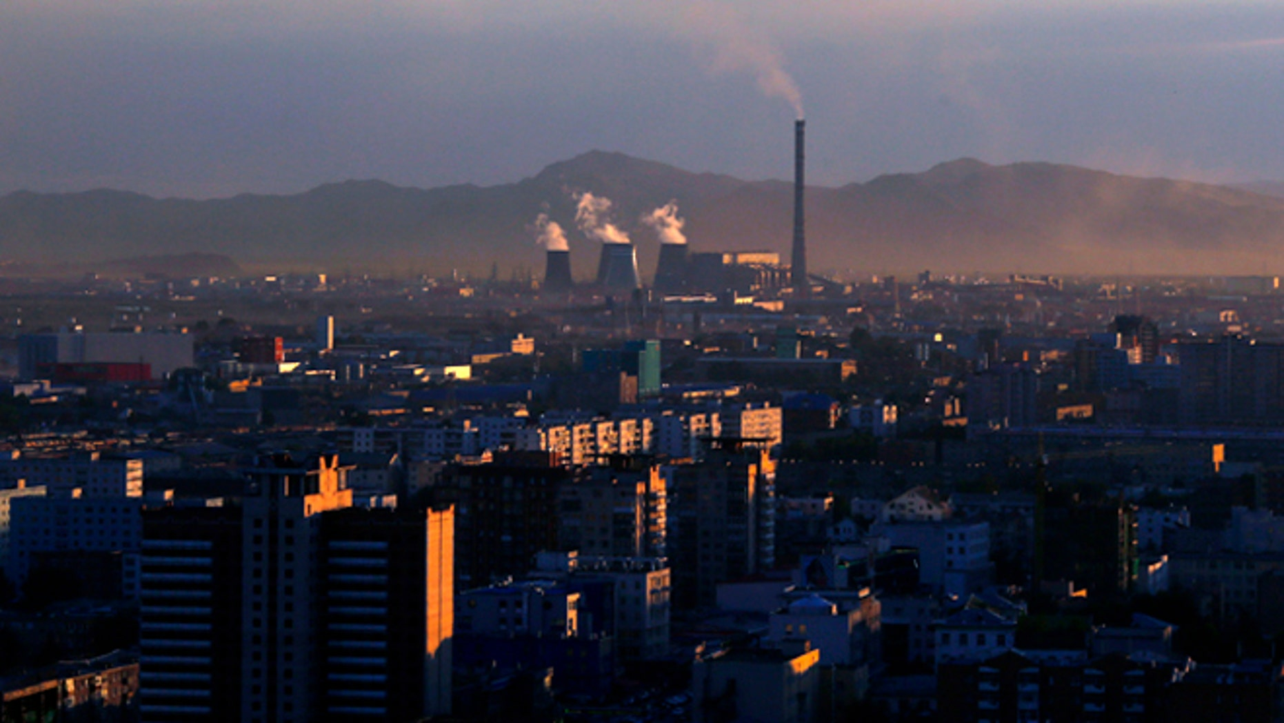 Smoke billows from the chimneys of a coal-burning power plant in Ulan Bator, Mongolia.