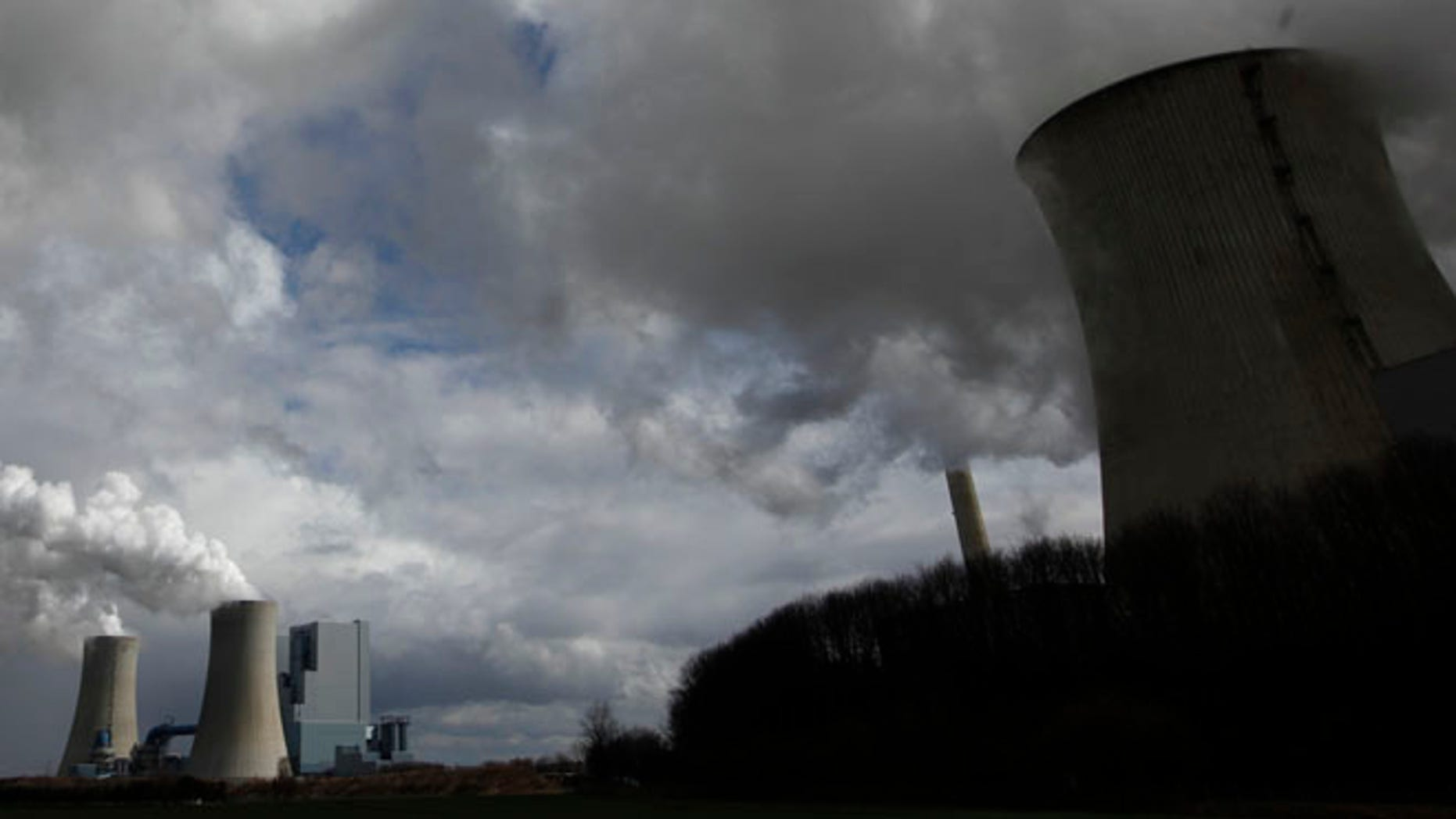 This file image shows steam rising from a coal power plant.