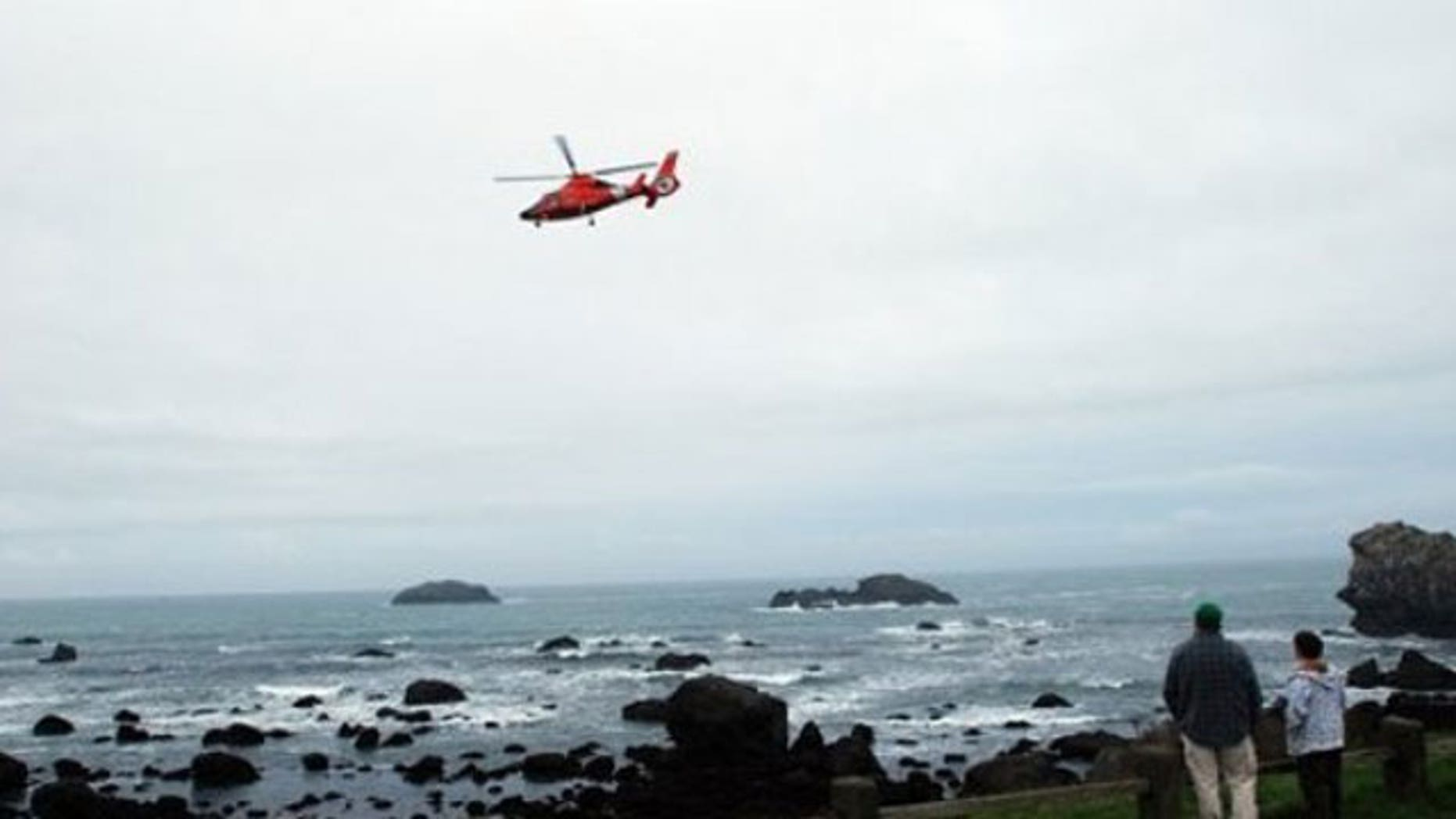 In this March 11, 2011 photo a Coast Guard MH-65 helicopter flies above Pebble Beach in Crescent City, Calif.