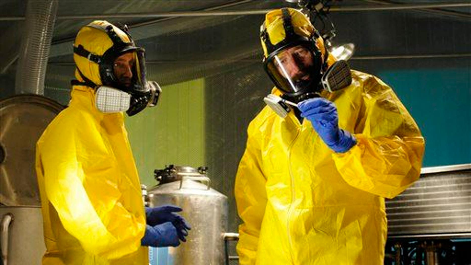"""Jesse Pinkman, played by Aaron Paul, left, and Walter White, played by Bryan Cranston, cooking meth in a home being fumigated in the fifth season of """"Breaking Bad."""""""