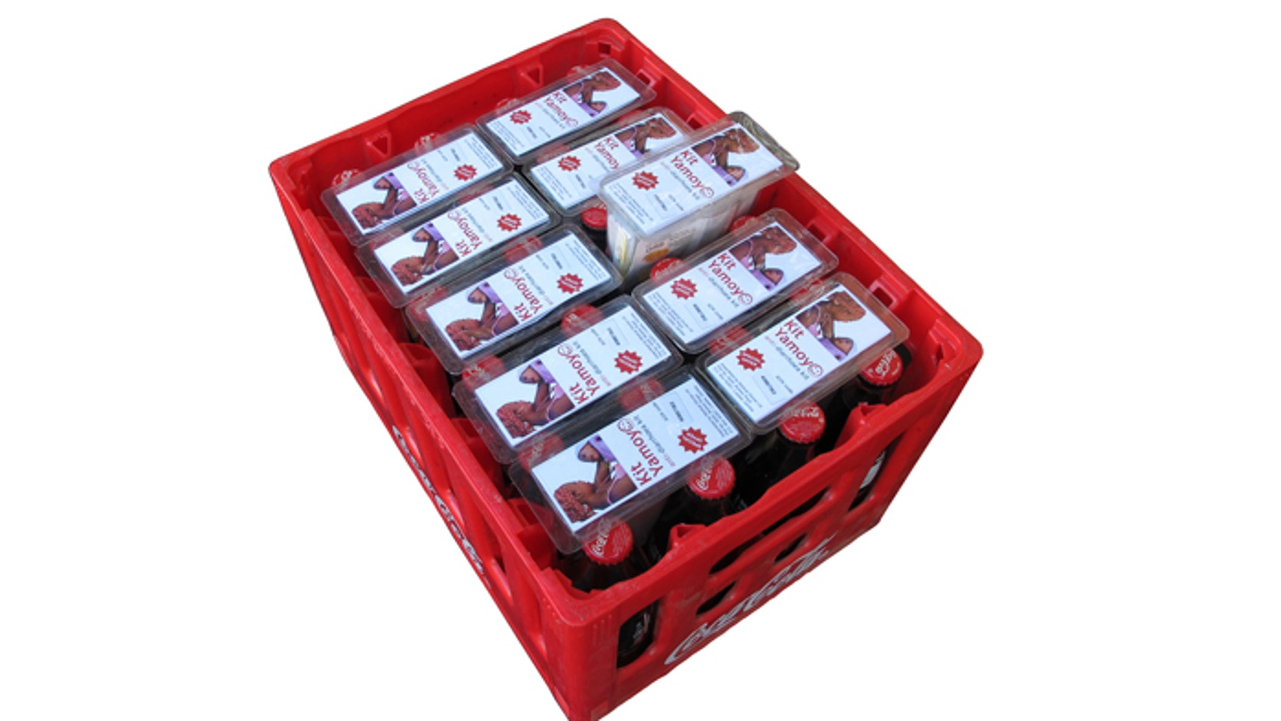 10 Kit Yamoyos fit into one crate of Coca-Cola and make use of the unused space between the necks of the bottles.