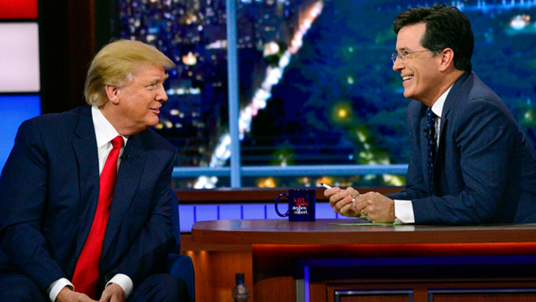 In this photo provided by CBS, Republican presidential candidate Donald Trump, left, joins host Stephen Colbert on the set of âThe Late Show with Stephen Colbert,â Tuesday, Sept. 22, 2015, in New York. (John Paul Filo/CBS via AP) MANDATORY CREDIT; NO ARCHIVE; NO SALES; NORTH AMERICAN USE ONLY