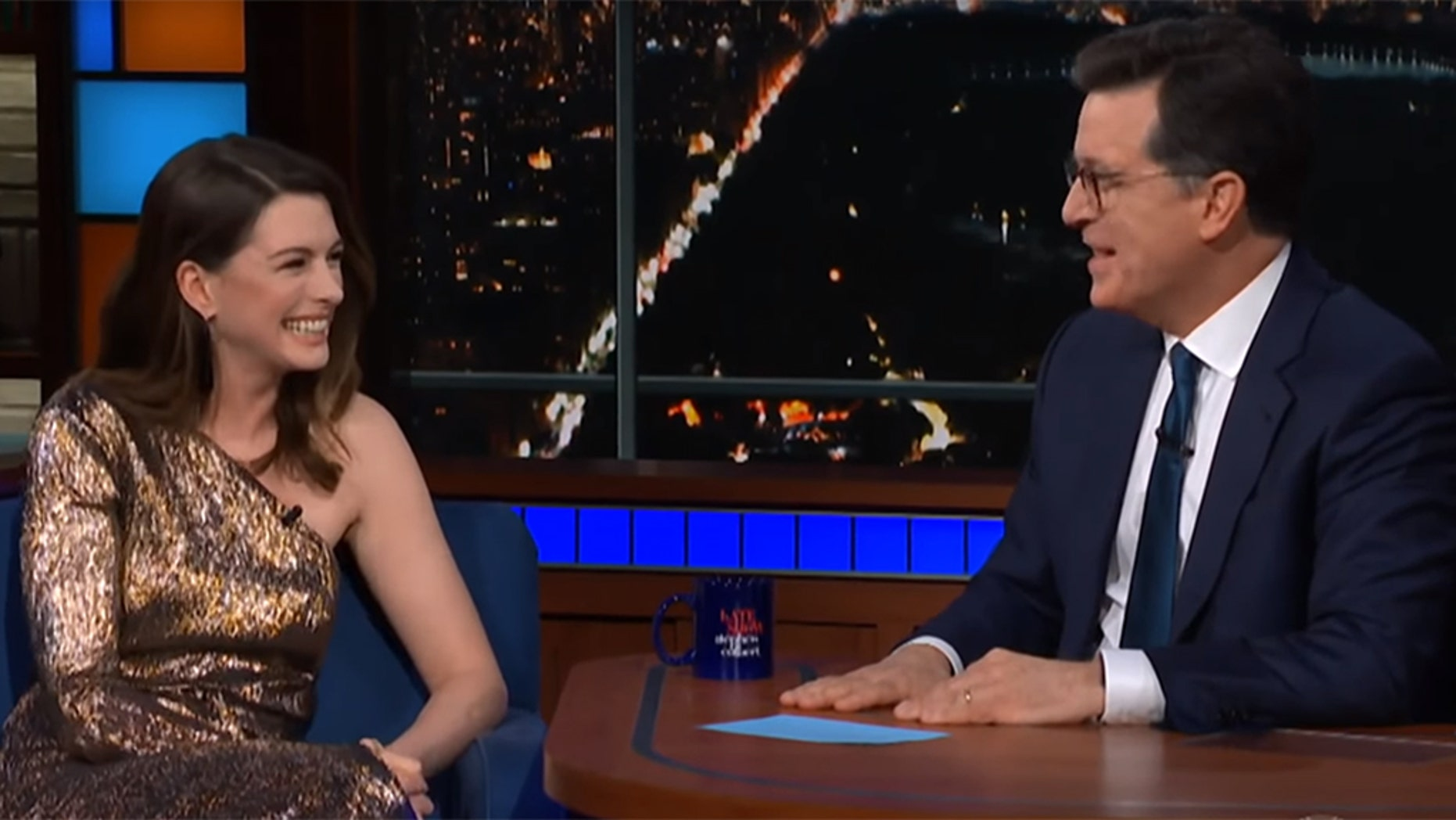 Anne Hathaway and Stephen Colbert rewatch the actress' first ever TV commercial that she booked at the age of 14.