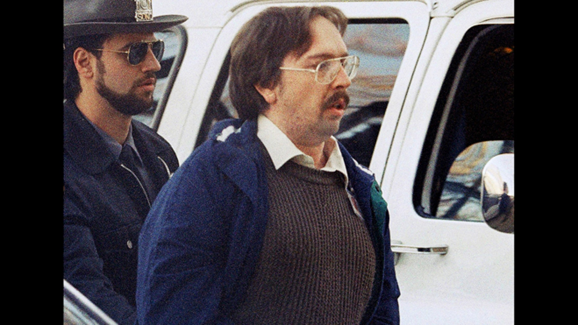 In this Dec. 17, 1993 file photo, Joel Rifkin, right, is led to the Nassau County Courthouse in Mineola, N.Y., for a suppression hearing.  New Jersey State Police said Wednesday, March 27, 2013, that 25-year-old Heidi Balch likely was the first victim of Rifkin, who is in prison in New York after admitting he killed 17 women in the early 1990s. Balchs severed head was found on a golf course in Hopewell Township, near Trenton, N.J., in March 1989.