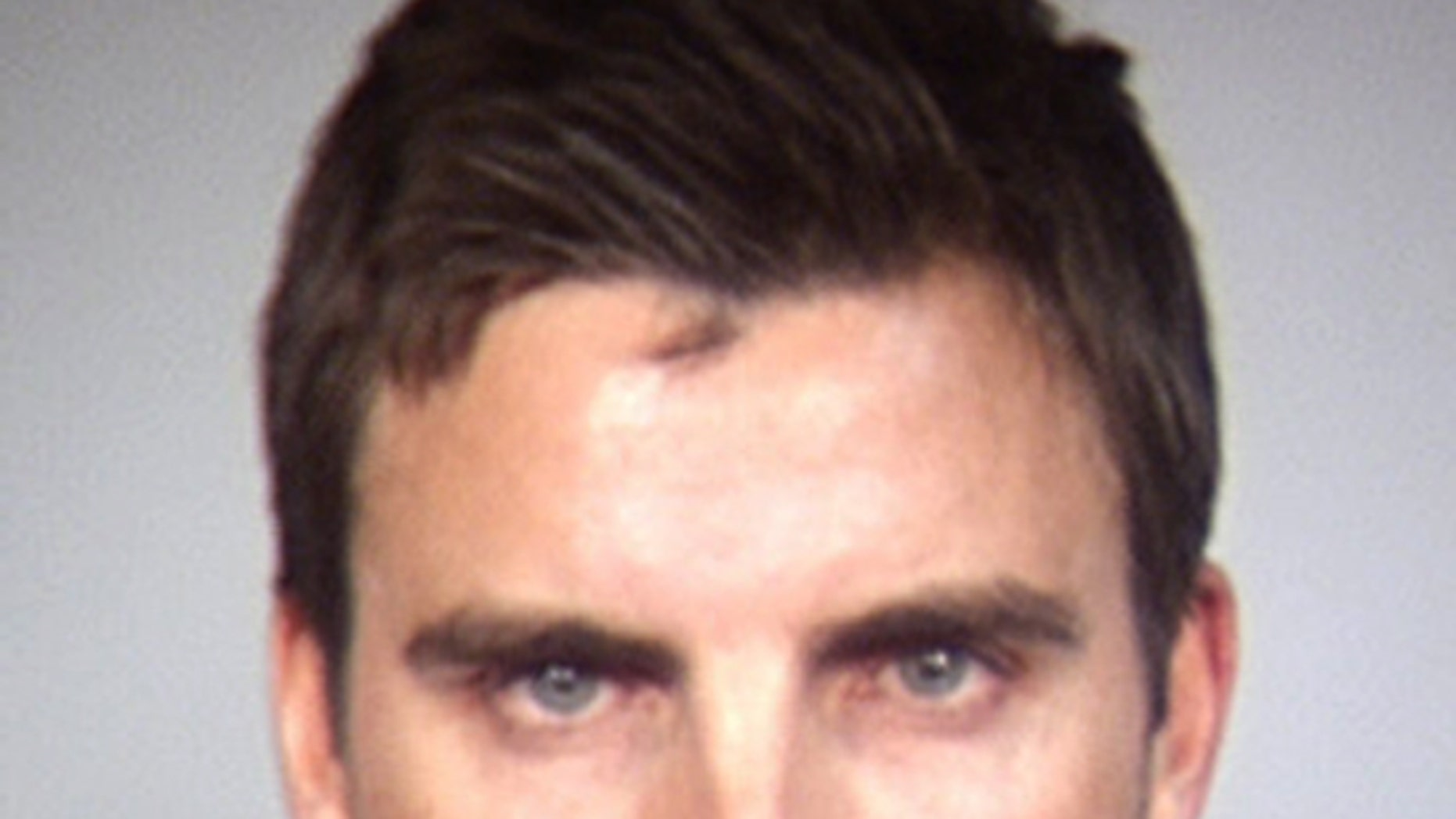 In this Tempe Police Department booking photo released Wednesday, April 2, 2014, shows Colin Egglesfield in Tempe, Ariz.