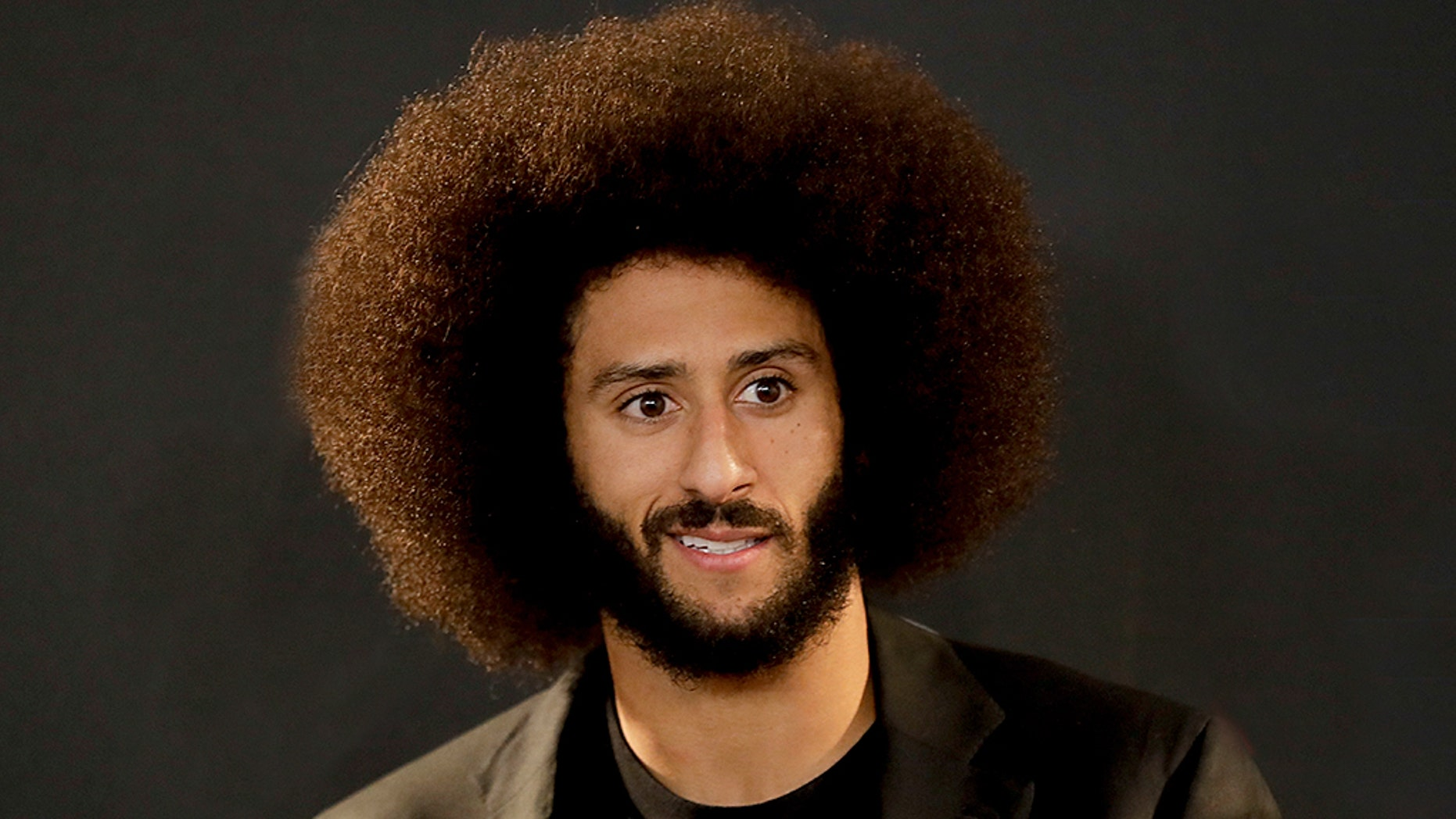 "Colin Kaepernick received The National Education Association's President's Award for his ""social justice activism"" on Sunday."