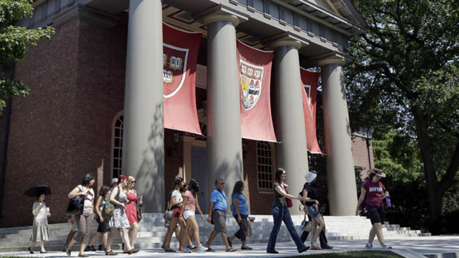 FILE - In this Aug. 30, 2012, file photo, people are led on a tour on the campus of Harvard University in Cambridge, Mass.  (AP Photo)