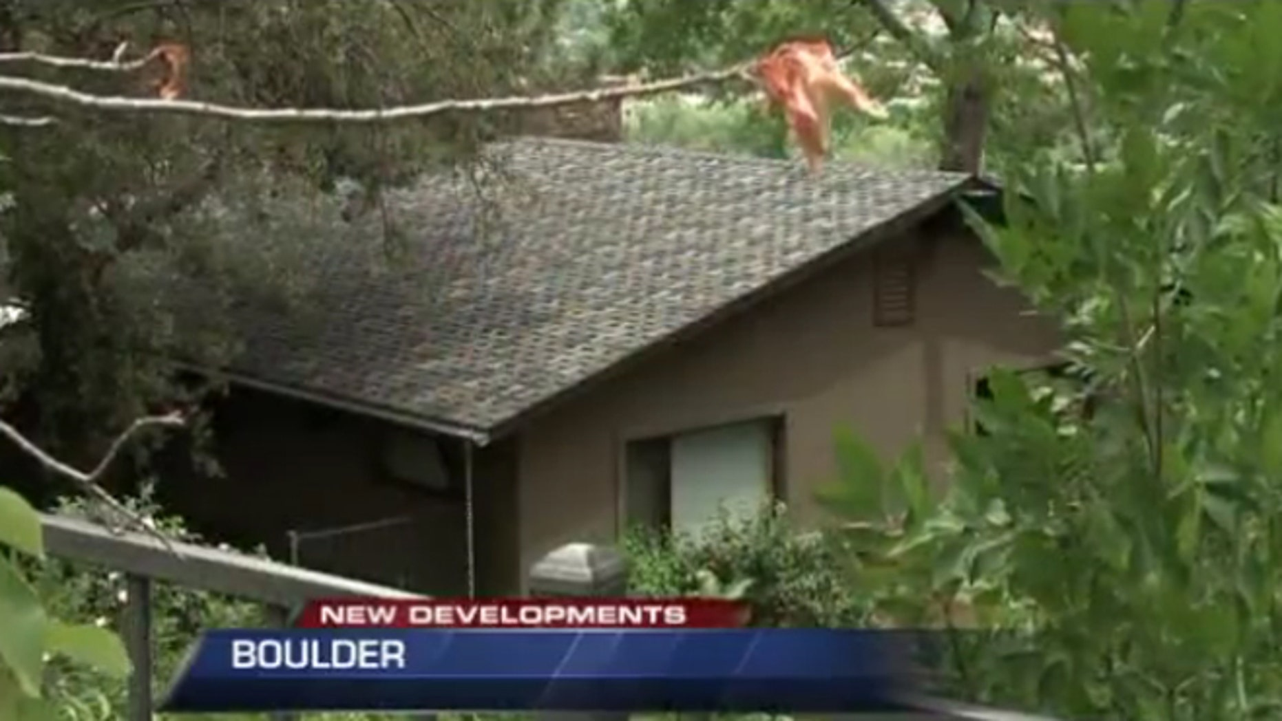 A recent University Colorado grad was shot after wandering into this house.