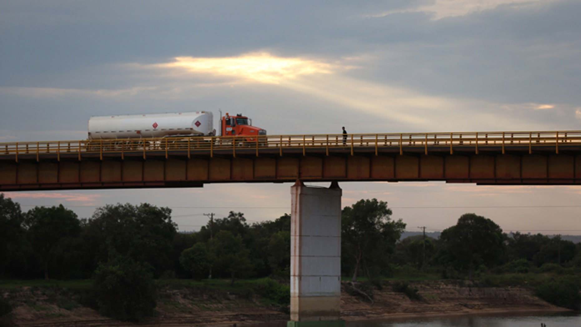 In this Feb. 13, 2015 photo, a truck loaded with crude from the Campo Rubiales oil field crosses the bridge over the Manacacias River in Puerto Gaitan, Colombia. A net oil importer not too long ago, Colombia is now the fifth biggest supplier to the U.S. (AP Photo/Fernando Vergara)
