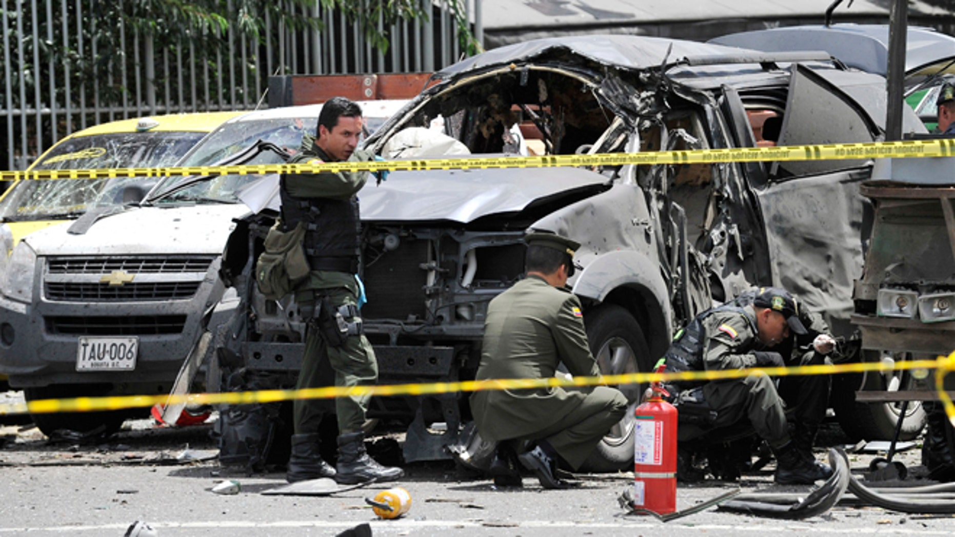 May 15, 2012: Police inspect the scene after a bomb exploded in Bogota, Colombia.