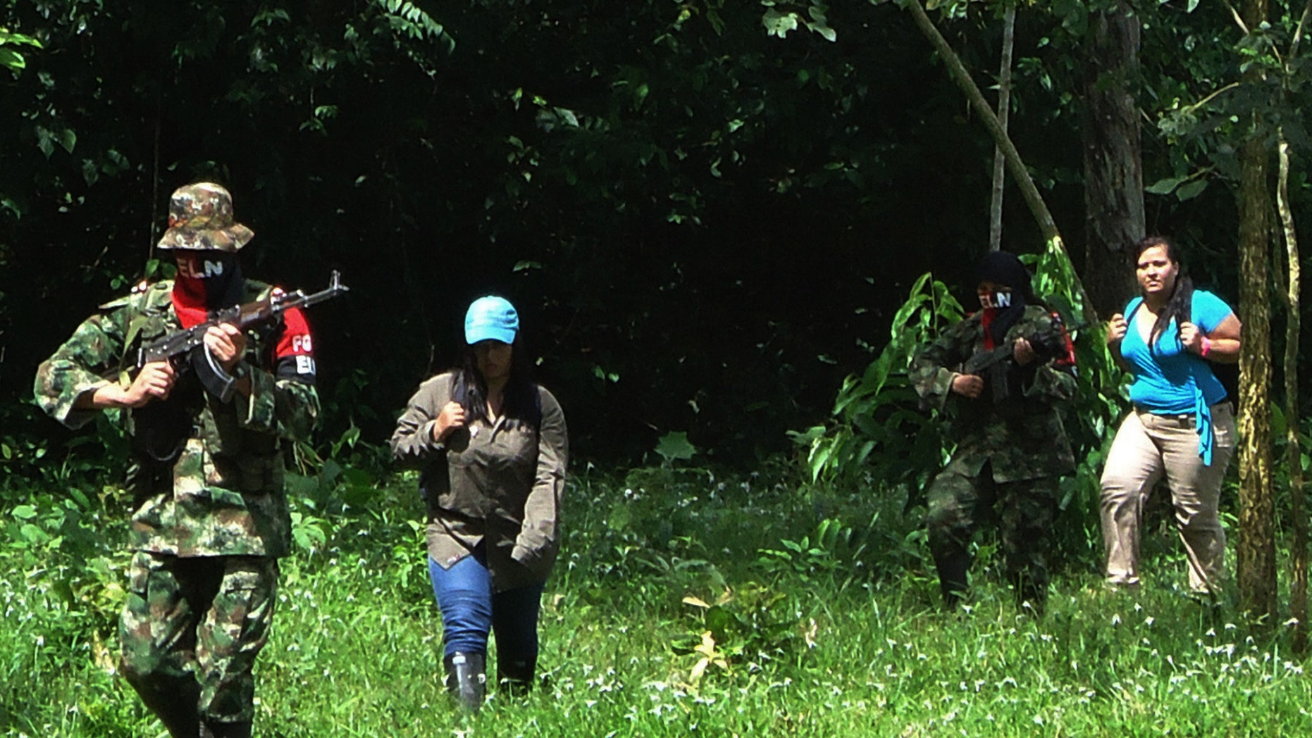 Aug. 13, 2012: Members of the Colombian rebel group National Liberation Army, or ELN,  escort Gina Paola Uribe Villamizar, 32, second from left, and Elida Parra Alfonso, 33, right, during their released in Fortul, northeast of Bogota, Colombia.