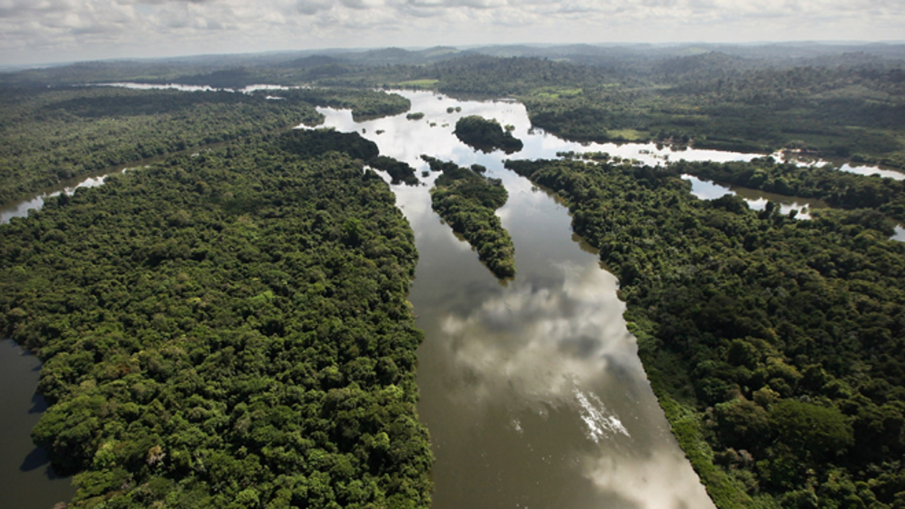 NEAR ALTAMIRA, BRAZIL - JUNE 15: The Xingu River flows near the area where the Belo Monte dam complex is under construction in the Amazon basin on June 15, 2012 near Altamira, Brazil. Belo Monte will be the world's third-largest hydroelectric project and will displace up to 20,000 people while diverting the Xingu River and flooding as much as 230 square miles of rainforest. The controversial project is one of around 60 hydroelectric projects Brazil has planned in the Amazon to generate electricity for its rapidly expanding economy. While environmentalists and indigenous groups oppose the dam, many Brazilians support the project. The Brazilian Amazon, home to 60 percent of the world's largest forest and 20 percent of the Earth's oxygen, remains threatened by the rapid development of the country. The area is currently populated by over 20 million people and is challenged by deforestation, agriculture, mining, a governmental dam building spree, illegal land speculation including the occupation of forest reserves and indigenous land and other issues. Over 100 heads of state and tens of thousands of participants and protesters will descend on Rio de Janeiro, Brazil, later this month for the Rio+20 United Nations Conference on Sustainable Development or 'Earth Summit'. Host Brazil is caught up in its own dilemma between accelerated growth and environmental preservation.   (Photo by Mario Tama/Getty Images)