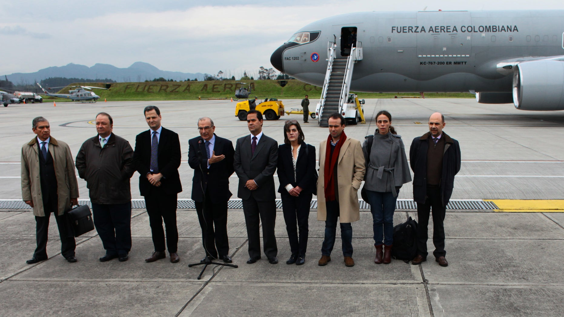 Oct. 16, 2012: Colombia's government team for the peace talks with Colombia's Revolutionary Armed Forces ( FARC ) pose for a photo before embarking on an Colombian Air Force plane to Oslo at the military airport in Bogota, Colombia.