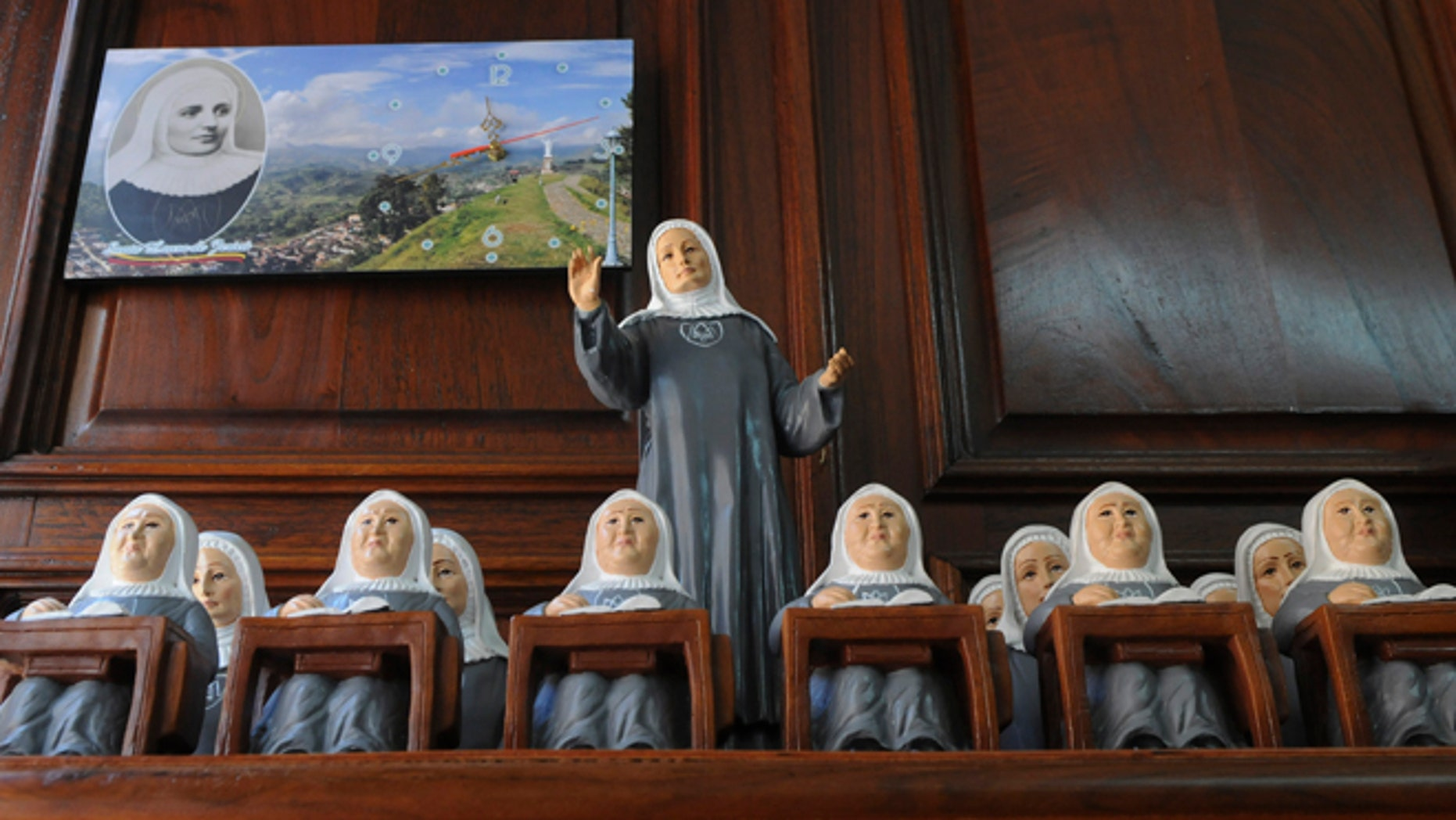 Statues of Mother Laura Montoya sit on display for sale in her hometown of Jerico, Colombia, Friday, May 10, 2013.  Mother Laura, who was born in 1874 and dedicated her life to working with indigenous and poor people, will become the country's first saint when Pope Francis canonizes her on Sunday. (AP Photo/Luis Benavides)